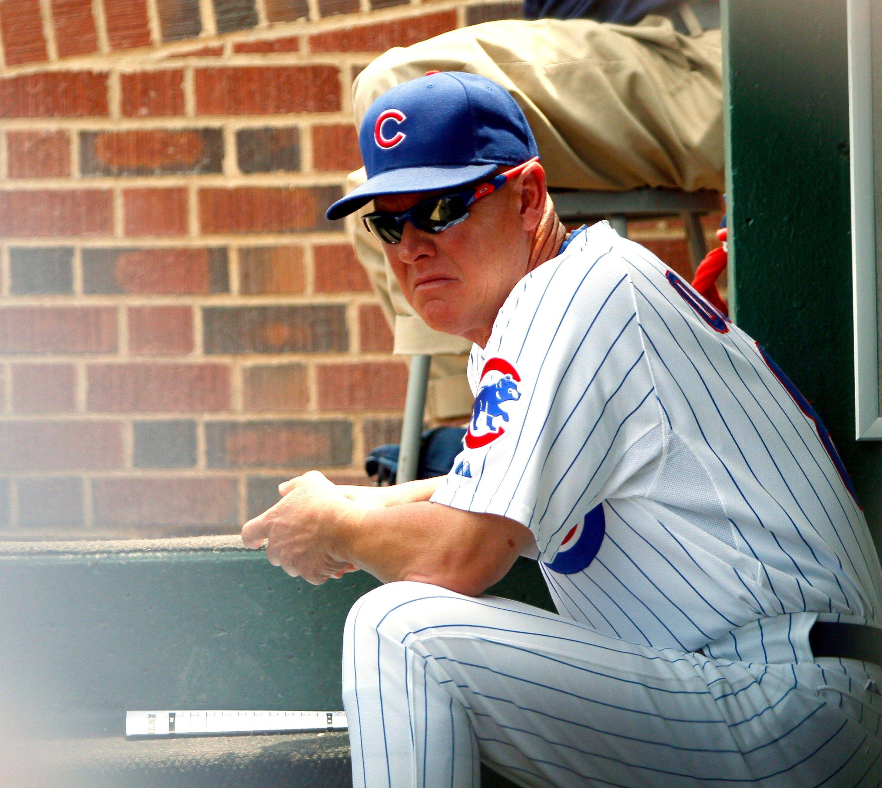 Chicago Cubs' manager Mike Quade reacts after a 7-5 loss to the Florida Marlins in a baseball game, Sunday, July 17, 2011, in Chicago.