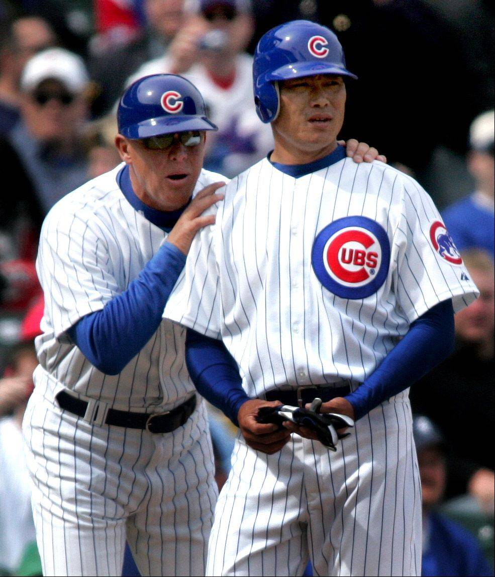 Third base Cubs coach Mike Quade with Kosuke Fukudome during a game against Milwaukee in 2008.