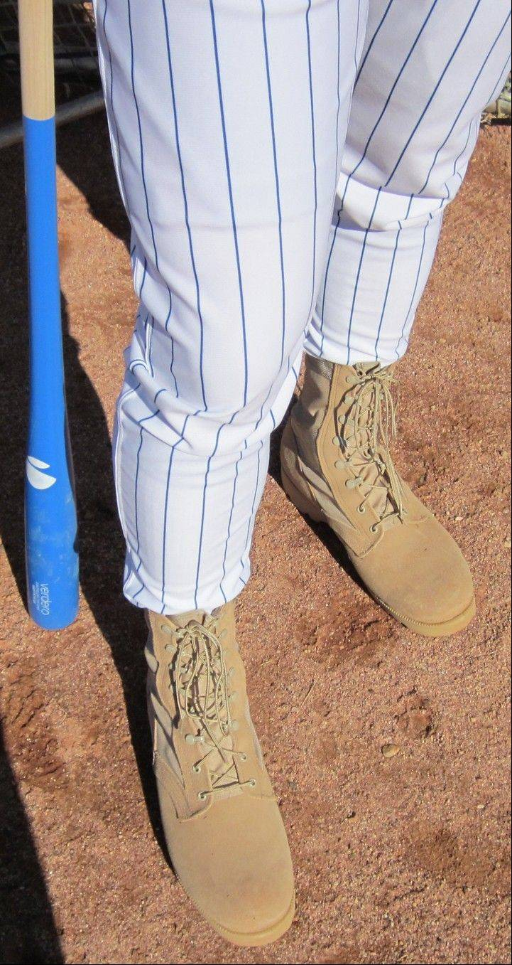 Cubs manager Mike Quade wore combat boots all day in training camp in Mesa, Ariz., to show his support for U.S. troops.