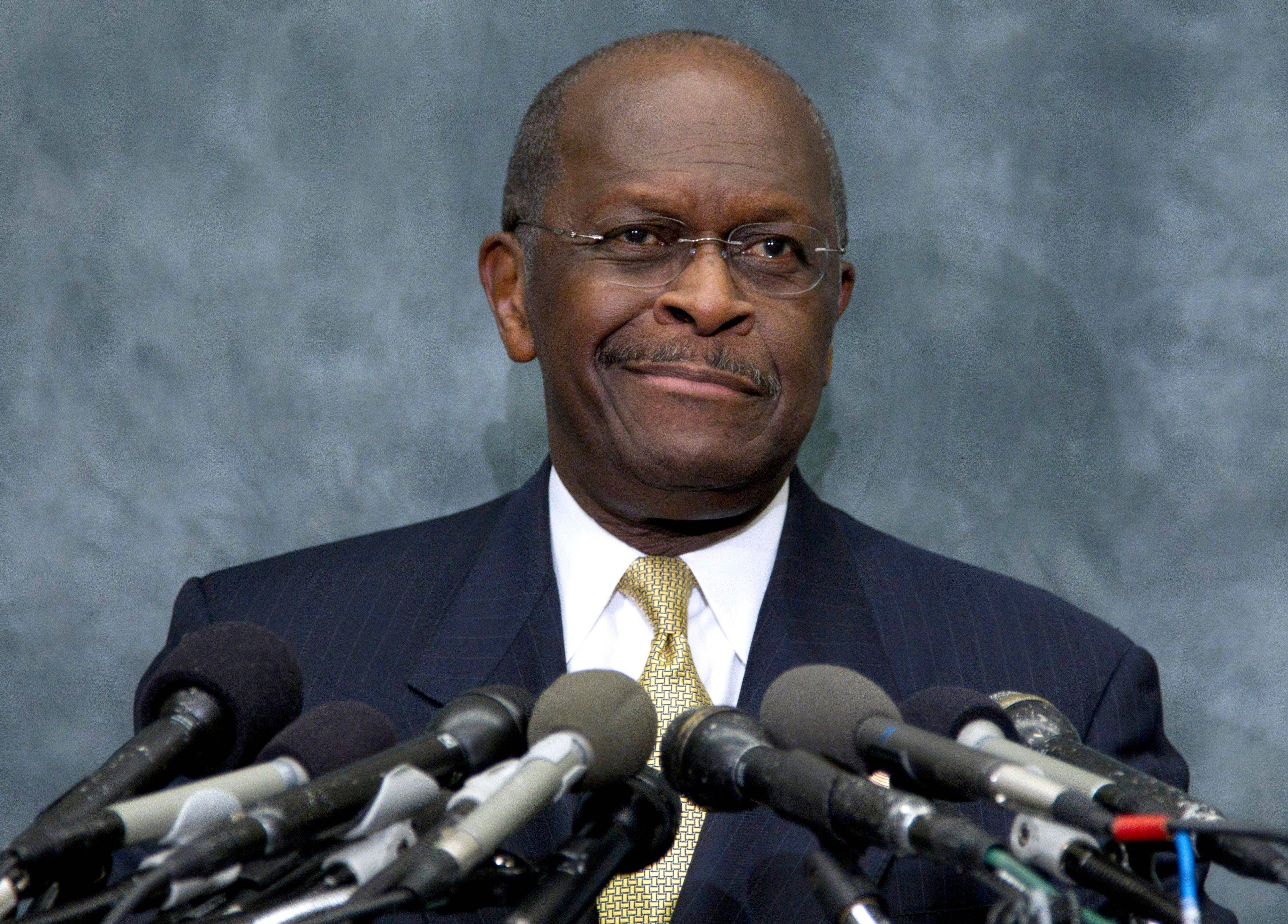Cain blames media, Perry for furor over harassment allegations