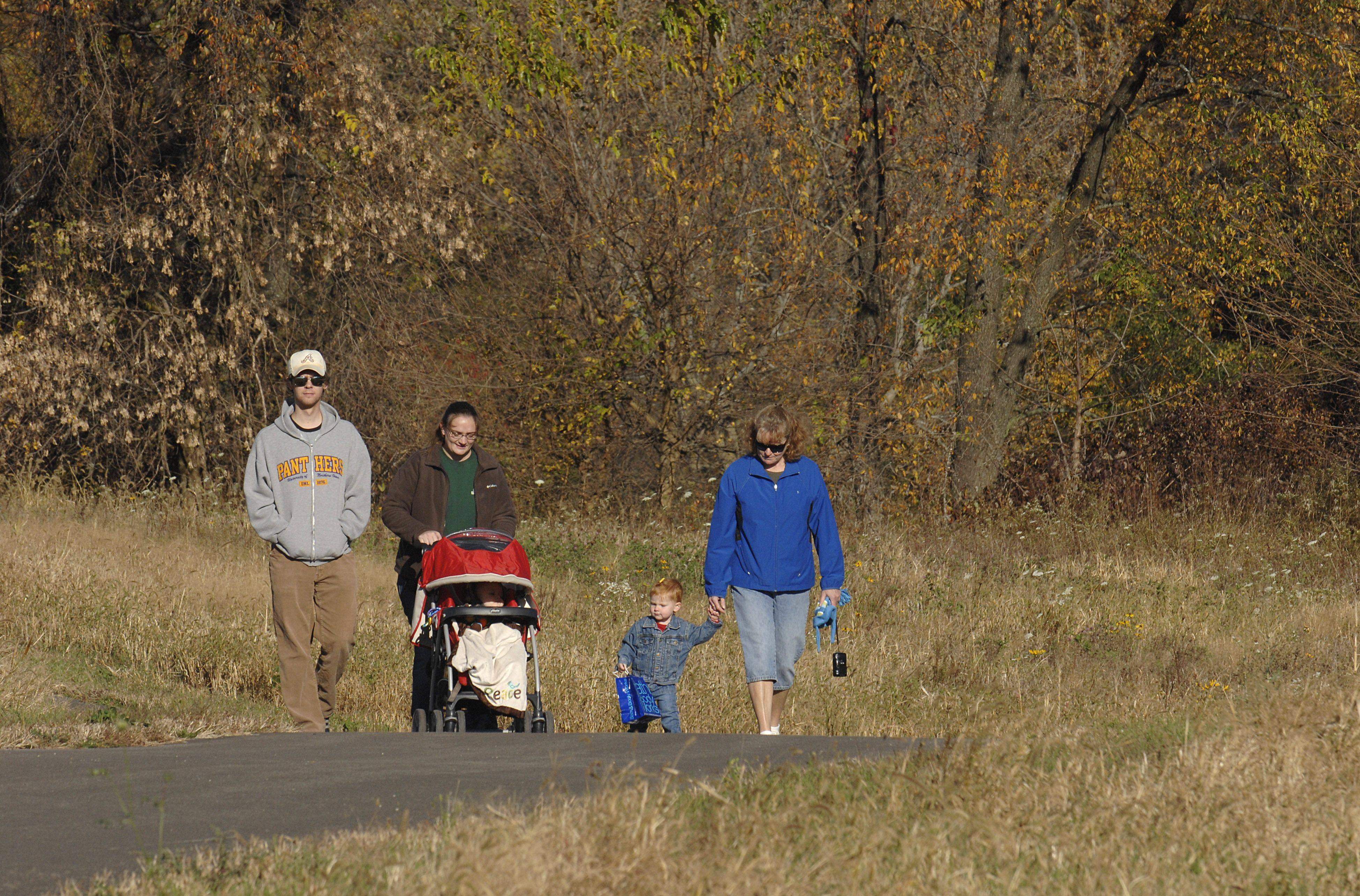 "Kane County naturalist Erica Lemon, second from left, leads a ""Nature by Stroller"" walk last October at Fitchie Creek Forest Preserve in Plato Township. Lemon is joined by son Owen, husband Craig, and Penny Mackall of Elgin with granddaughter, Madison Mackall of Oswego. Kane County Forest Preserve officials announced this week the purchase of 94 acres alongside Fitchie Creek that will increase the preserve to 467 acres."