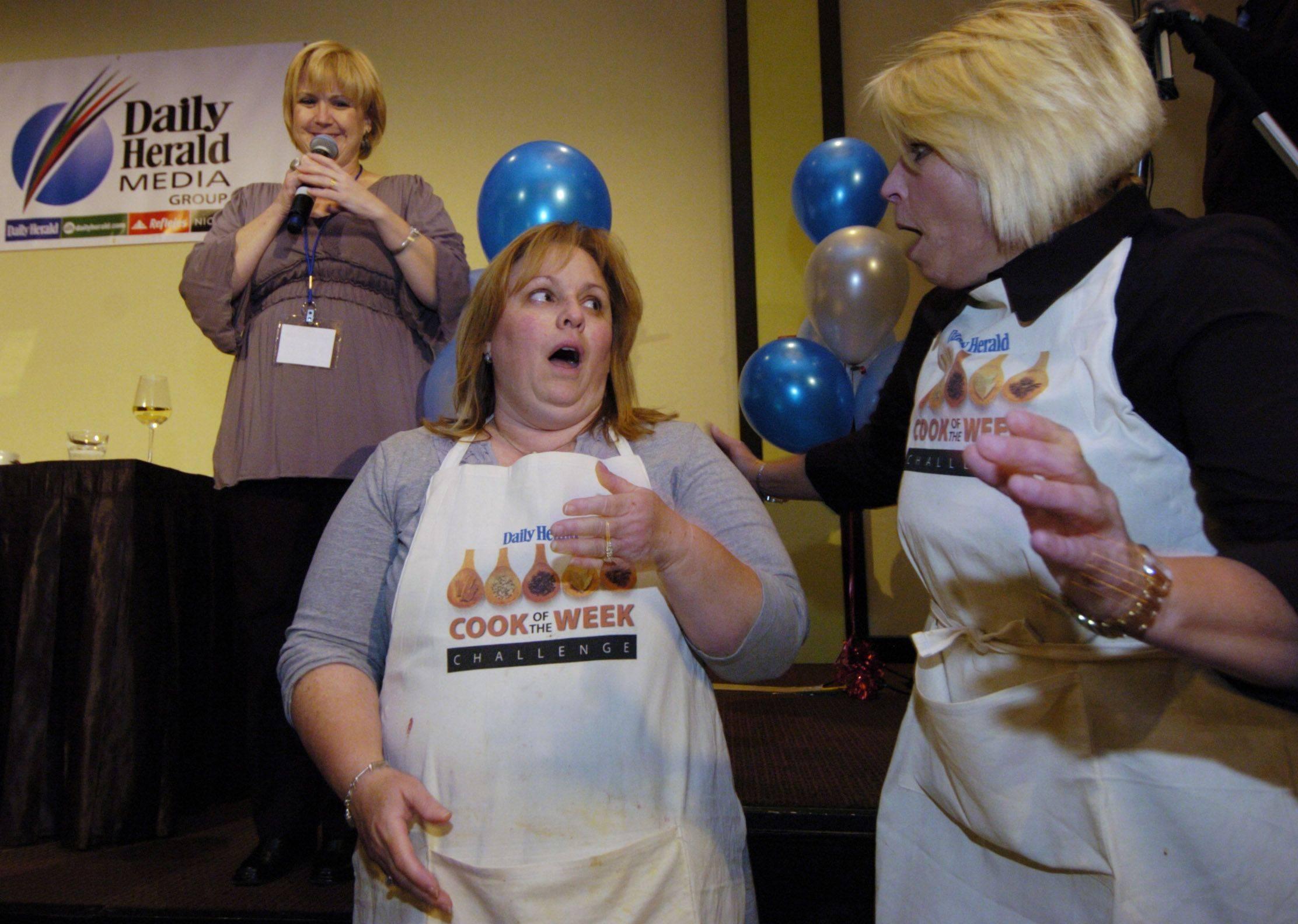 Penny Kazmier, center, of South Barrington reacts to the announcement that she won the Cook of the Week Challenge. Second-place finisher Cate Brusenbach of Antioch is at right, and Daily Herald Food Editor Deb Pankey is at left.