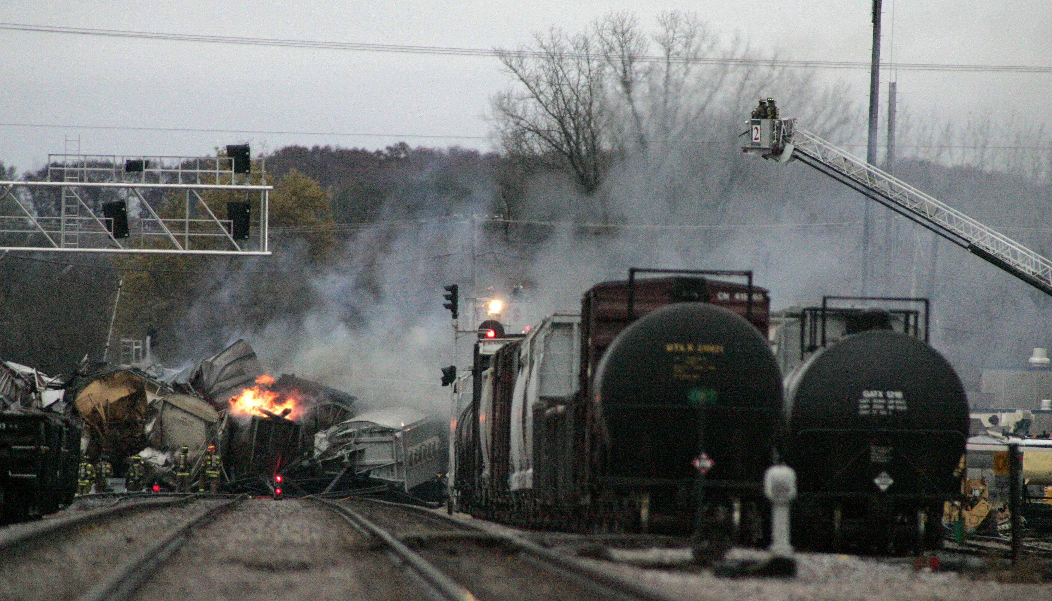 Smoke rises from a train derailment involving eight cars that spans the Elgin and Bartlett borders Thursday, November 3, 2011. The call was escalated to a MABAS Division 2 box alarm and caused major traffic delays in the area as well as bussing concerns for students at the U-46 School district.