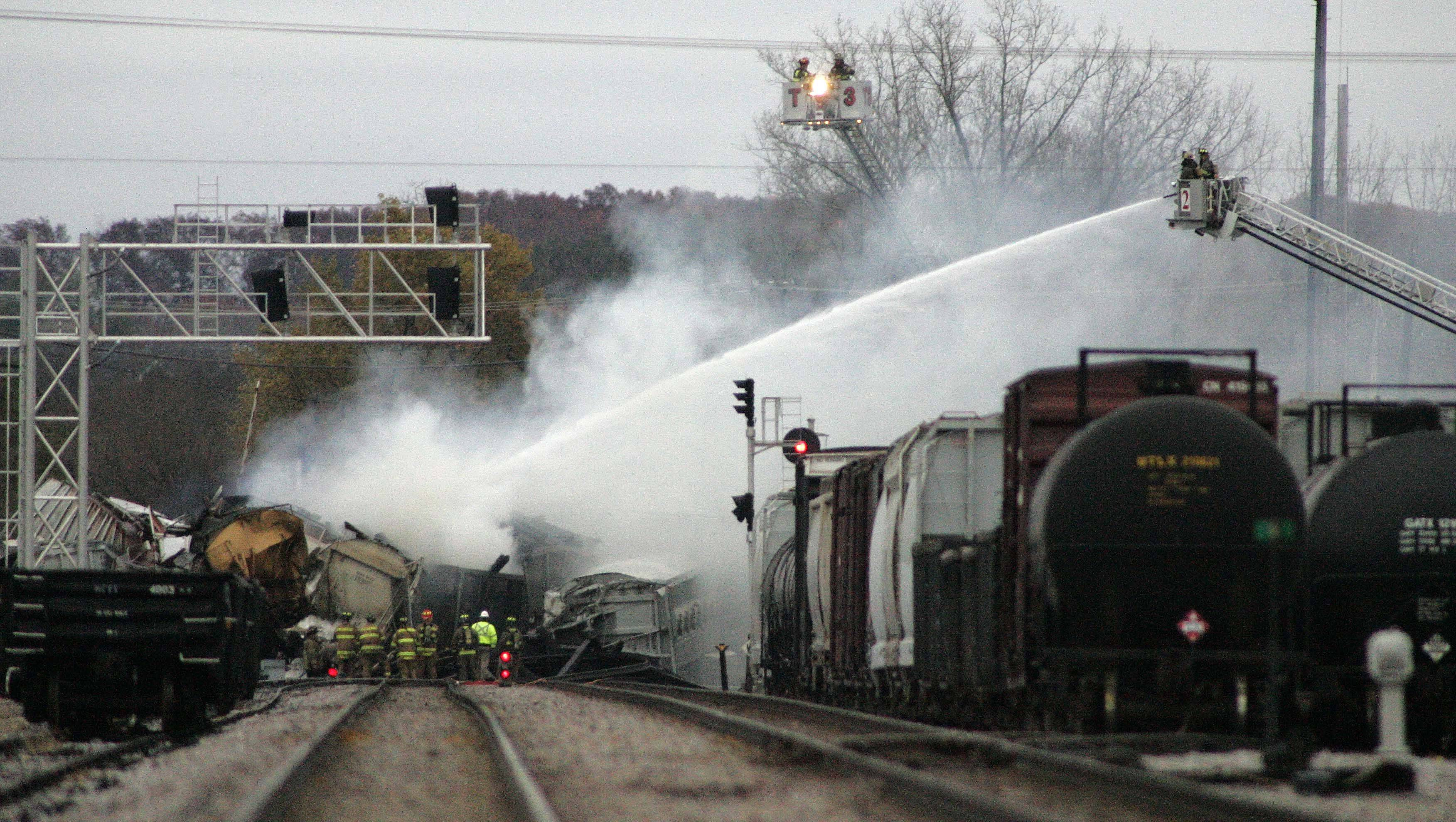 Smoke rises from a three-car train derailment near the Elgin-Bartlett border Thursday morning. Two of the cars that derailed contained hazardous materials, though officials say no chemicals were released.
