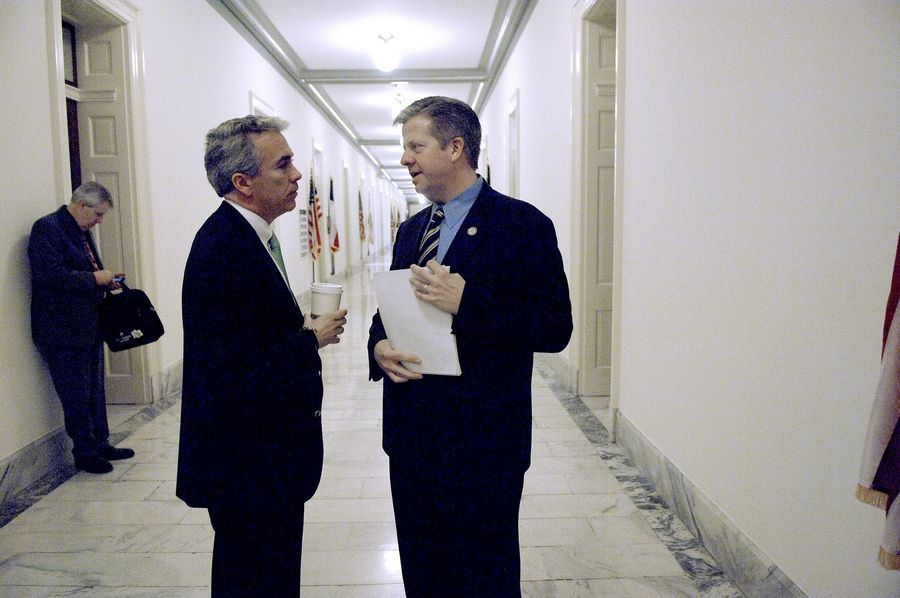 Joe Walsh, left, chats with fellow freshman congressman Randy Hultgren in the hallway of the Cannon House Office Building in Washington D.C. last March. The two are gearing up for a bitter and costly primary race against one another.