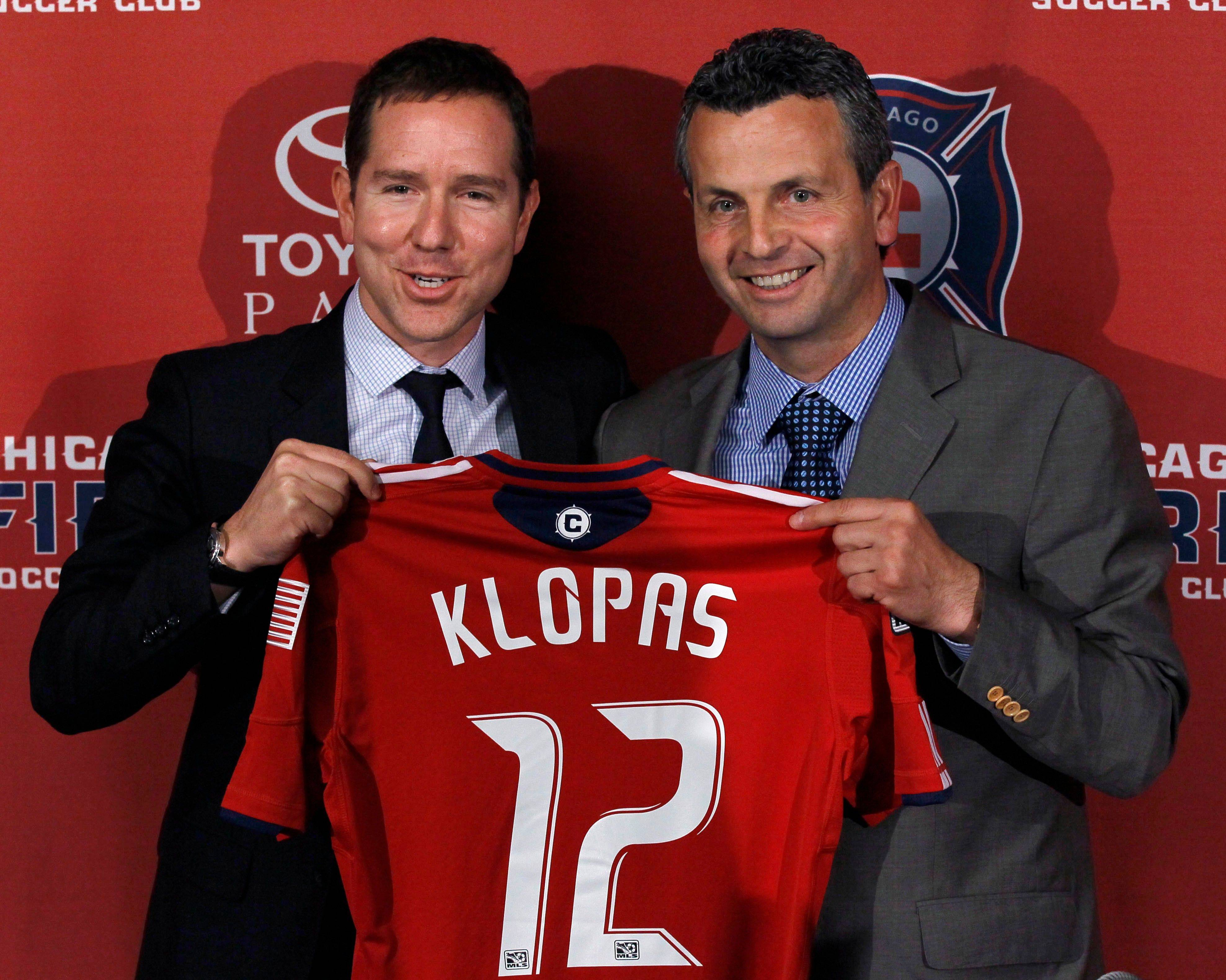 Fire owner Andrew Hauptman, left, poses with Frank Klopas on Thursday after naming Klopas the team's new coach.
