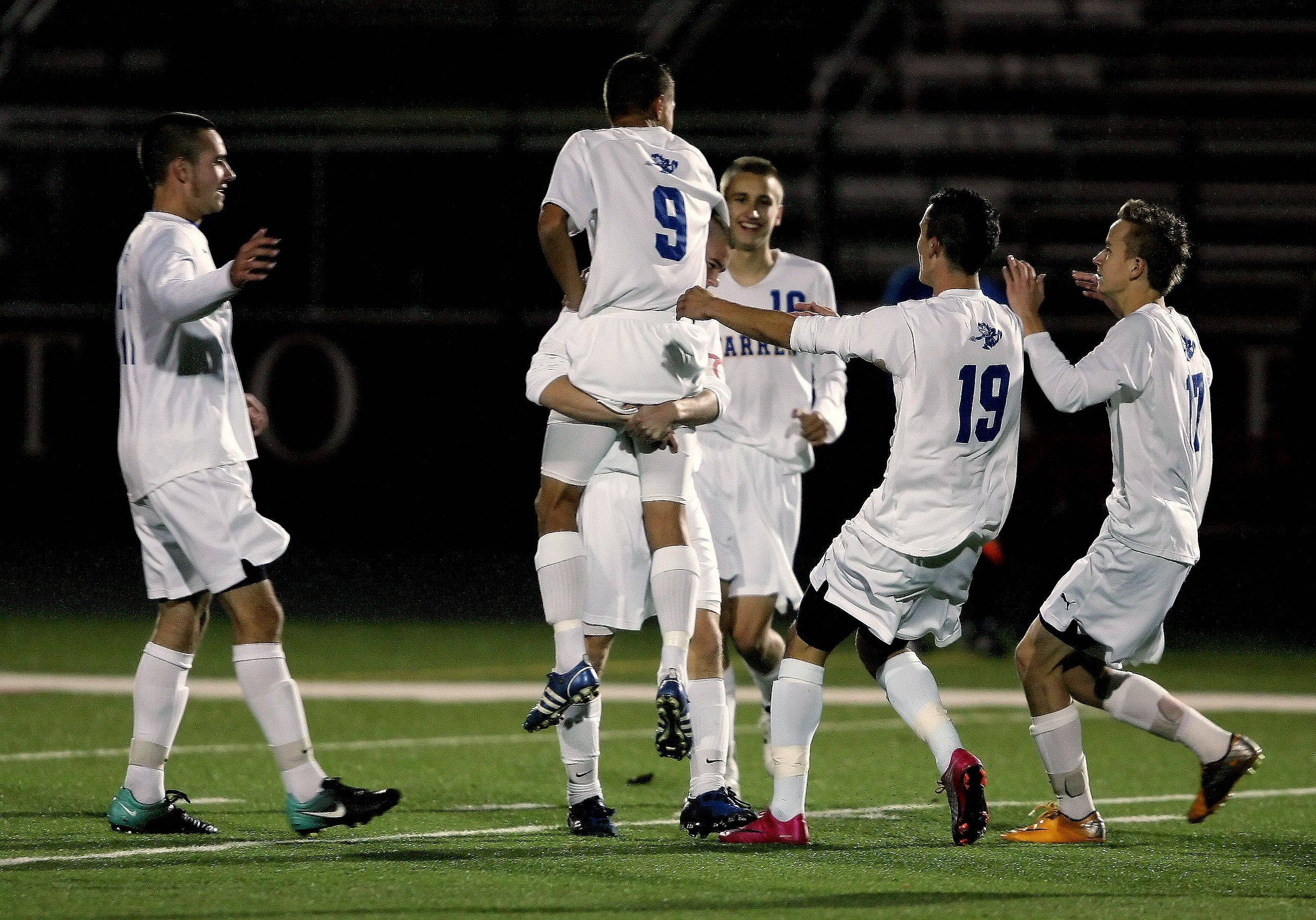 Warren teammates celebrate after Daniel Szczepanek scored the first goal of the game during the Class 3A Barrington boys soccer supersectional Tuesday featuring Warren against Schaumburg.