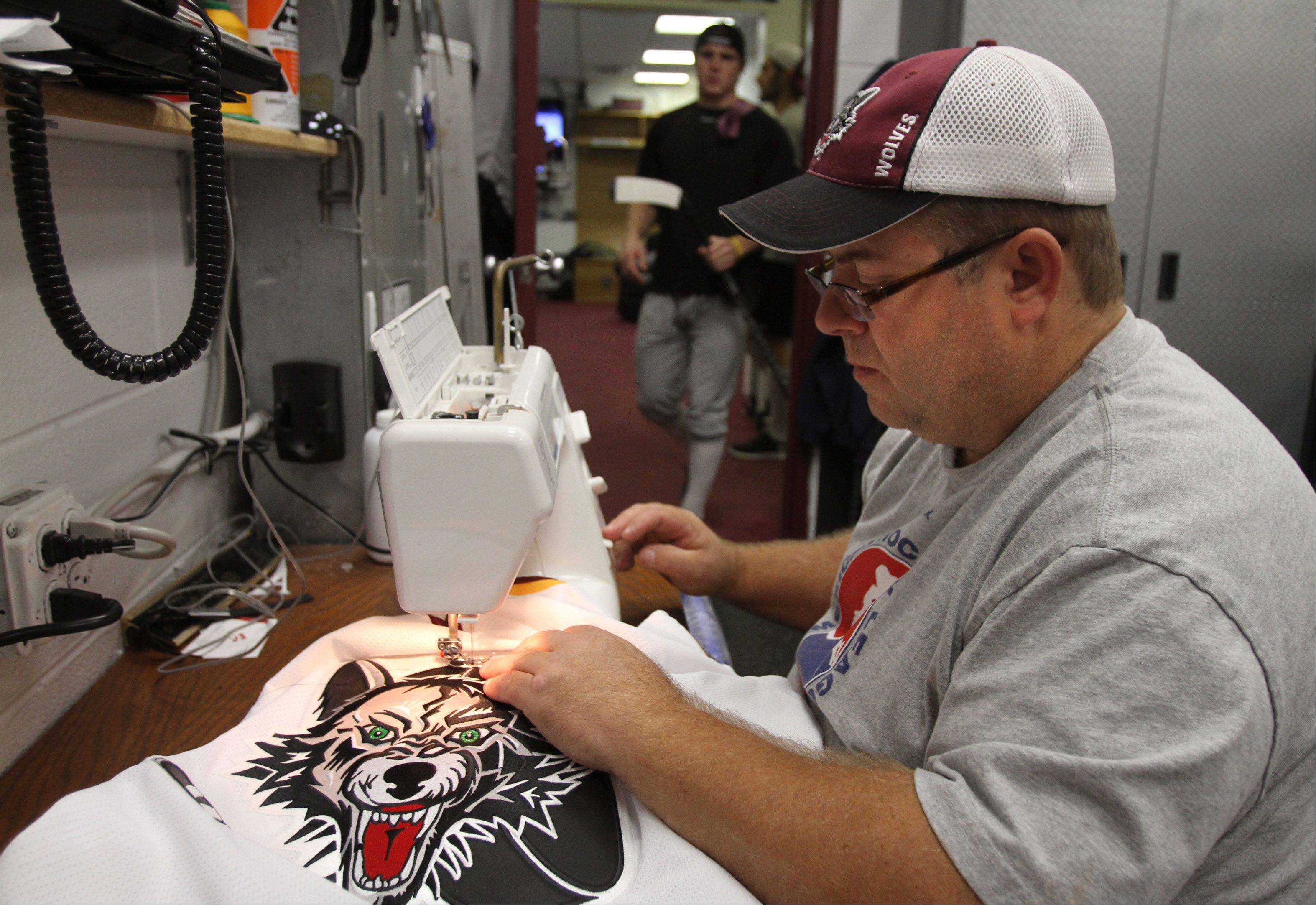 Sewing the team's logos on jerseys is part of the job for head equipment manager Craig Kogut.