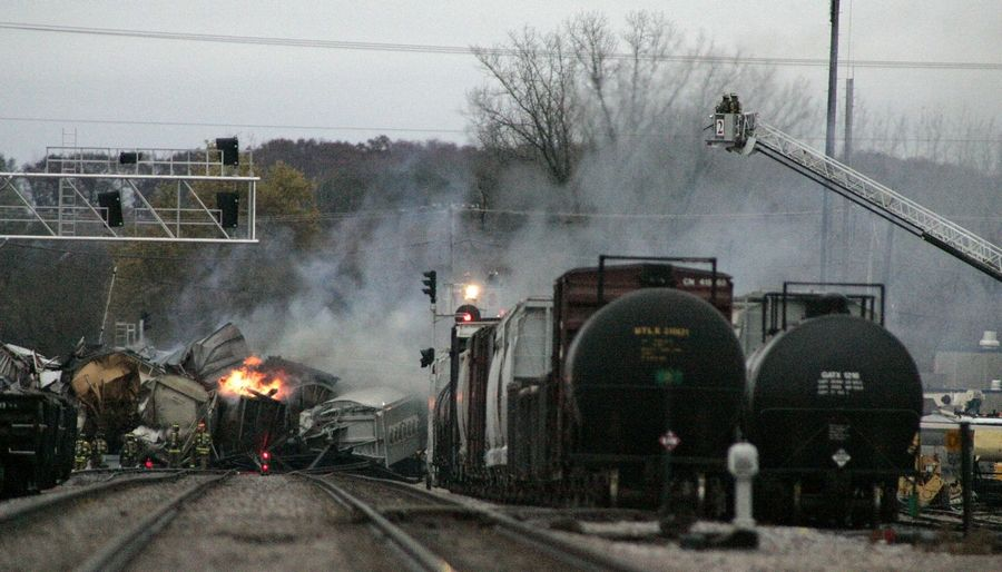 Smoke rises from a train derailment involving eight cars that spans the Elgin and Bartlett borders Thursday November 3 2011. The call was escalated to a MABAS Division 2 box alarm and caused major traffic delays in the area as well as bussing concerns for students at the U-46 School district.