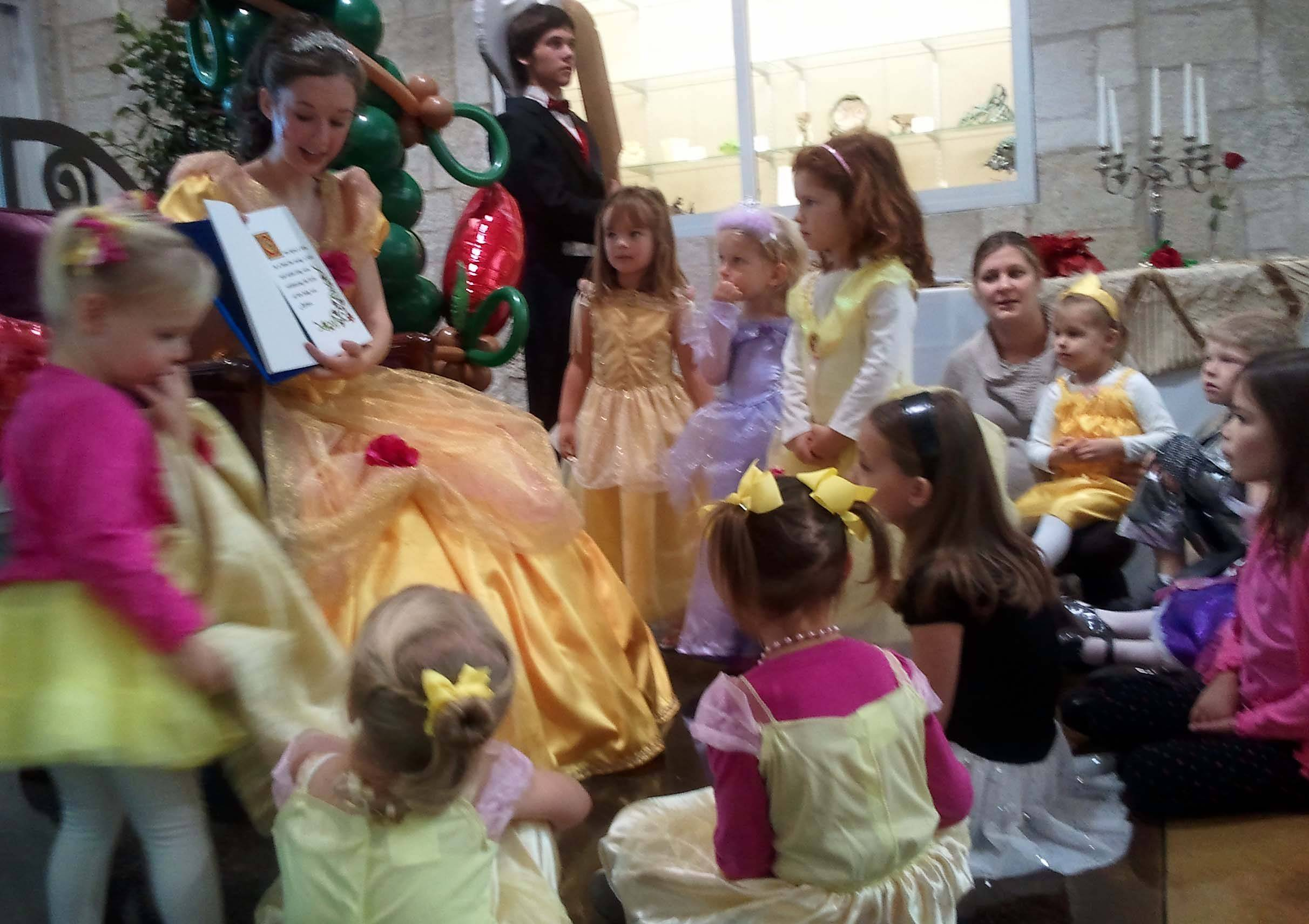 "Batavia High School sophomore Kelsey Skomer, who plays Belle in the school's ""Beauty and the Beast"" production, reads to her little admirers during a Character Breakfast held at the Batavia Fine Arts Centre Saturday."