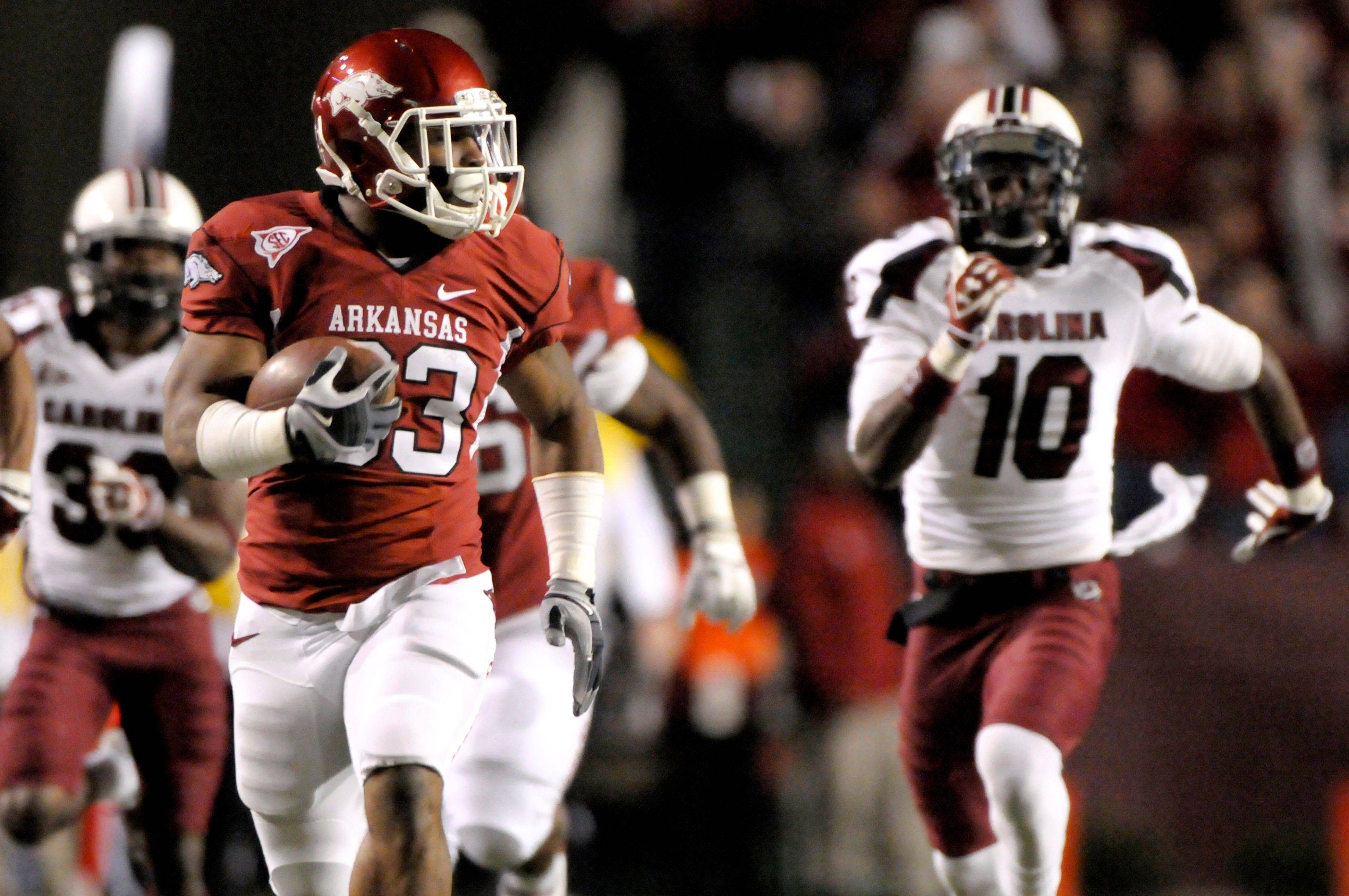 Arkansas' Dennis Johnson runs for the end zone to score on a kickoff return Saturday in Fayetteville, Ark.