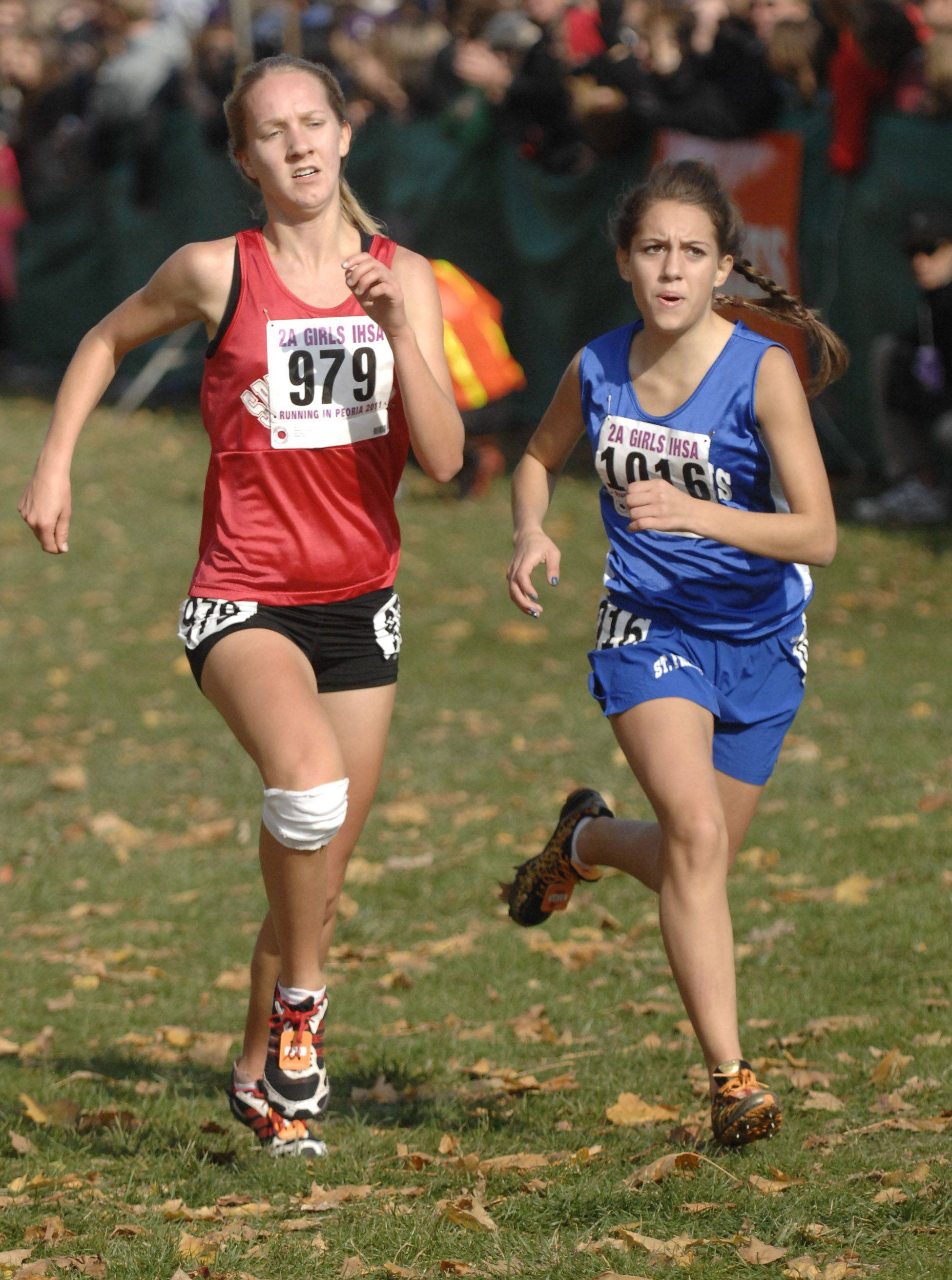 St. Francis' Jenna DiValerio gives one last sprint to get past Springfield's Maggie Cornelius near the finish line in the 2A state cross country final. DiValerio finished with a time of 18:16 in 32nd place.