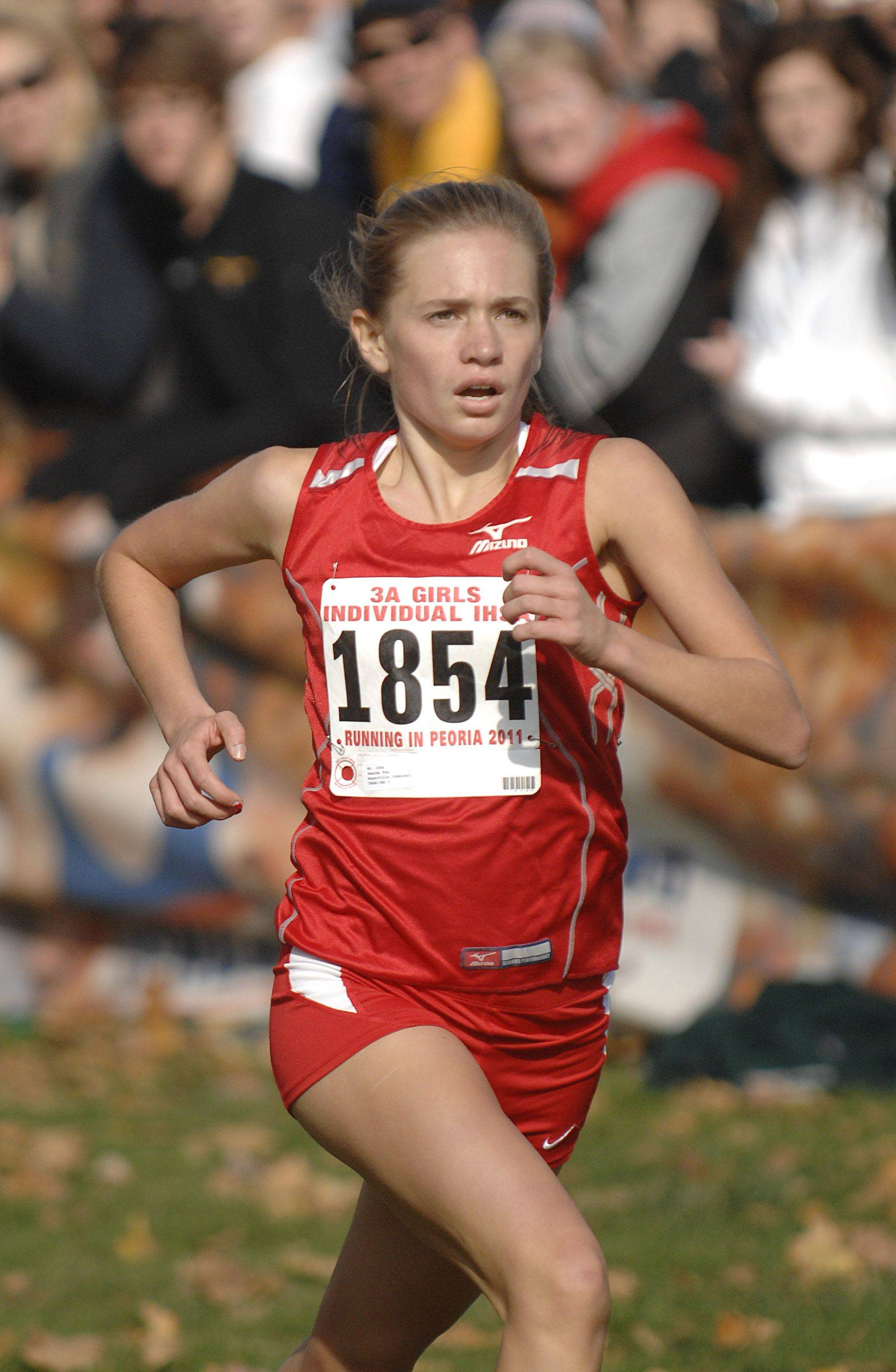 Naperville Central's Amanda Fox takes first place in the 3A state cross country final in Peoria on Saturday, November 5 with a time of 16:24.