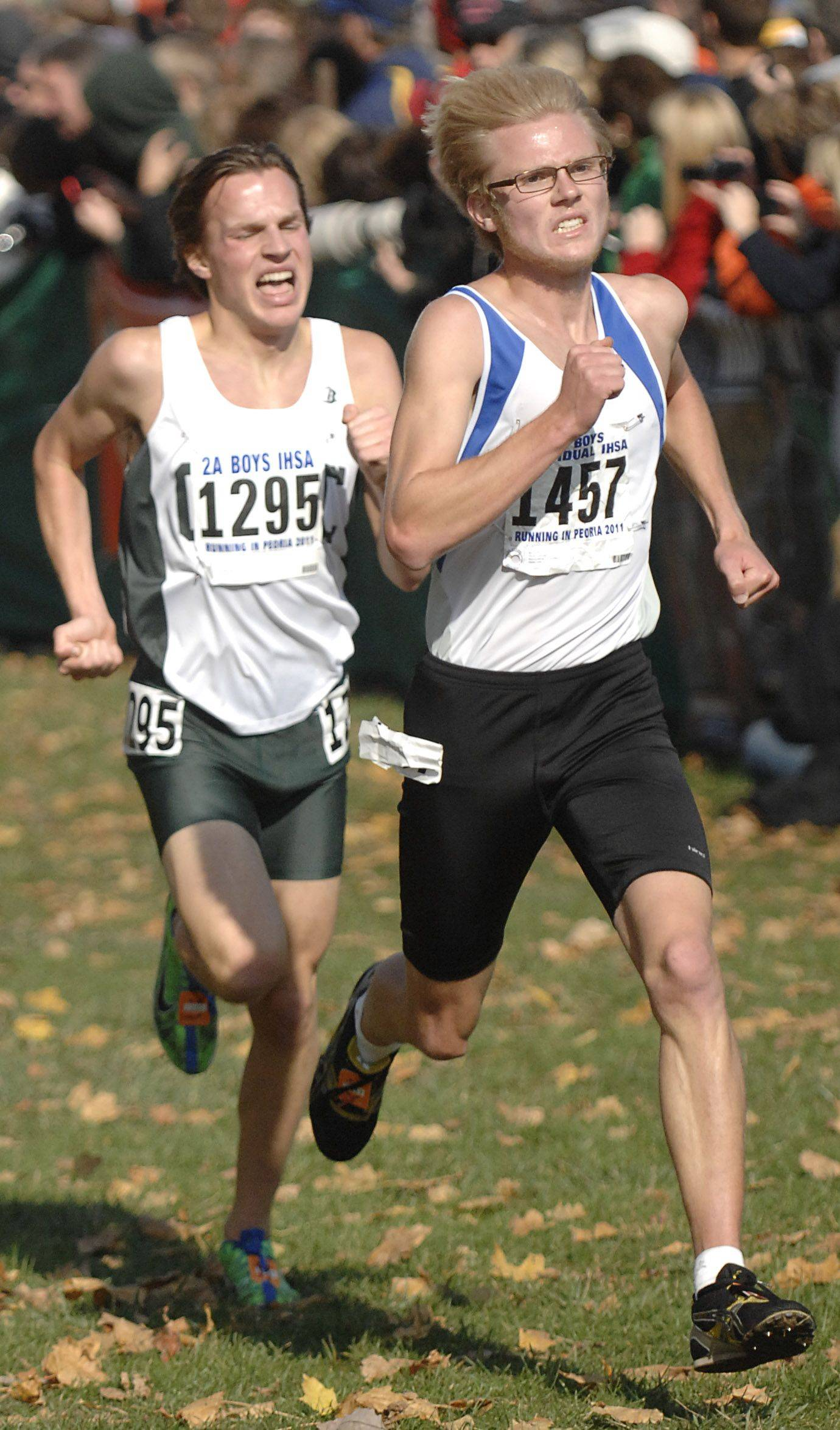 Burlington Central's Clint Kliem edges past Grayslake Central's Will Brewster near the finish line in the 2A state cross country final in Peoria on Saturday, November 5.