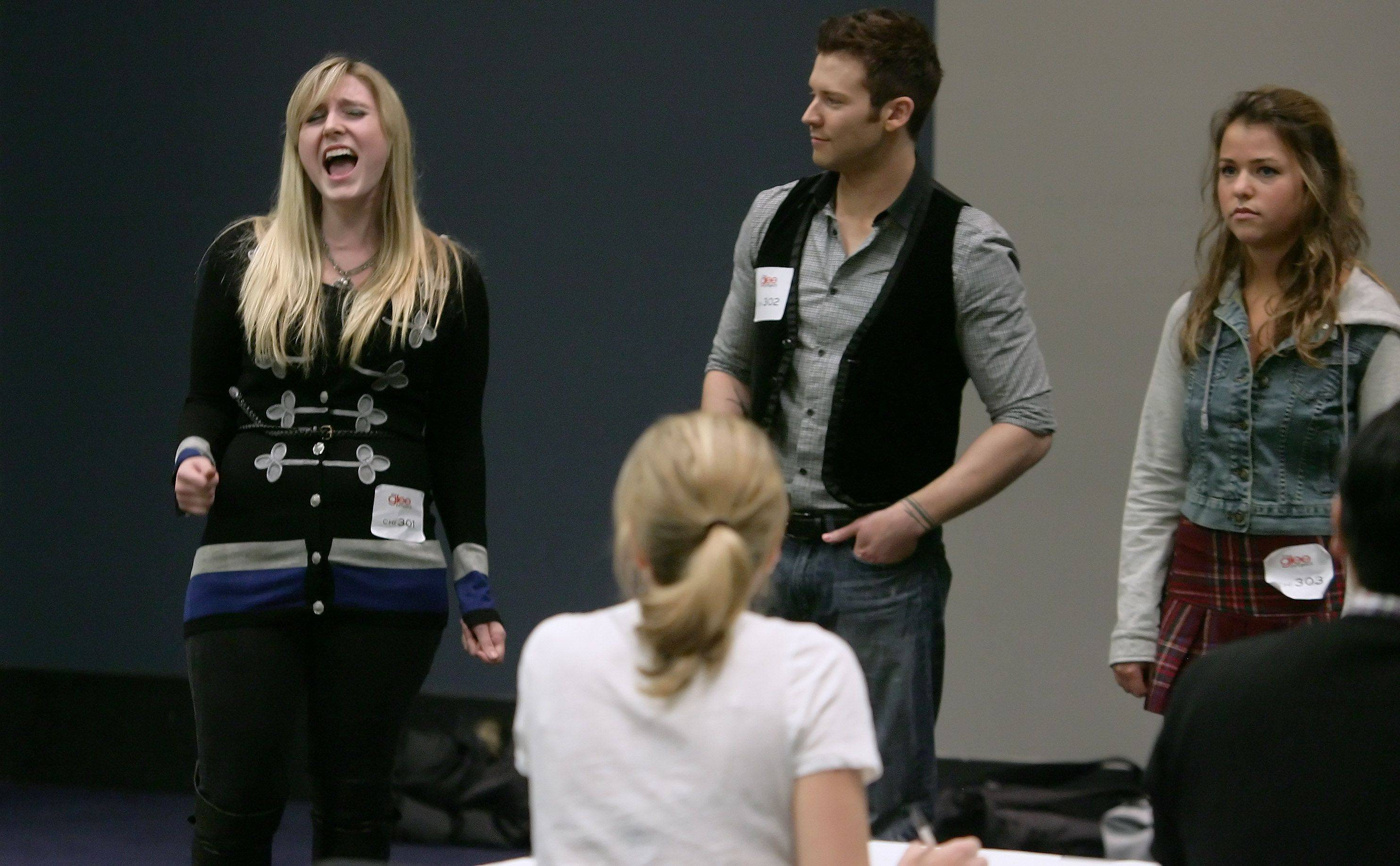 "Anna Perrotti of Wheaton performs before the judges during tryouts for the reality series ""The Glee Project"" Sunday at McCormick Place in Chicago. The competition offers contestants a chance to win a part on the award winning FOX television show ""Glee."""