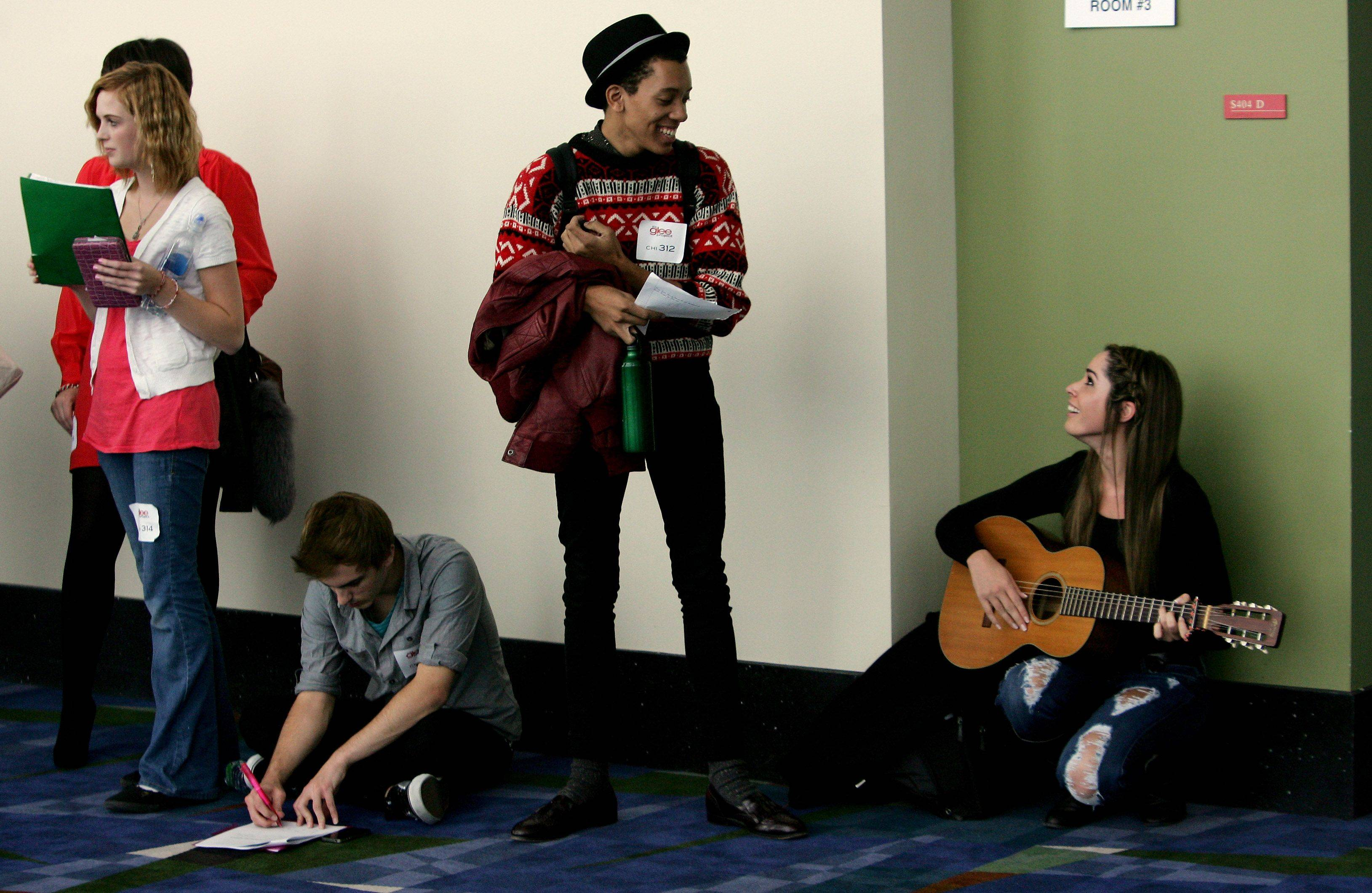 "Melissa Meister of Northbrook, right, plays the guitar and talks to Jerome Riley of St. Louis during tryouts for the reality series ""The Glee Project"" Sunday at McCormick Place in Chicago. The competition offers contestants a chance to win a part on the award winning FOX television show ""Glee."""