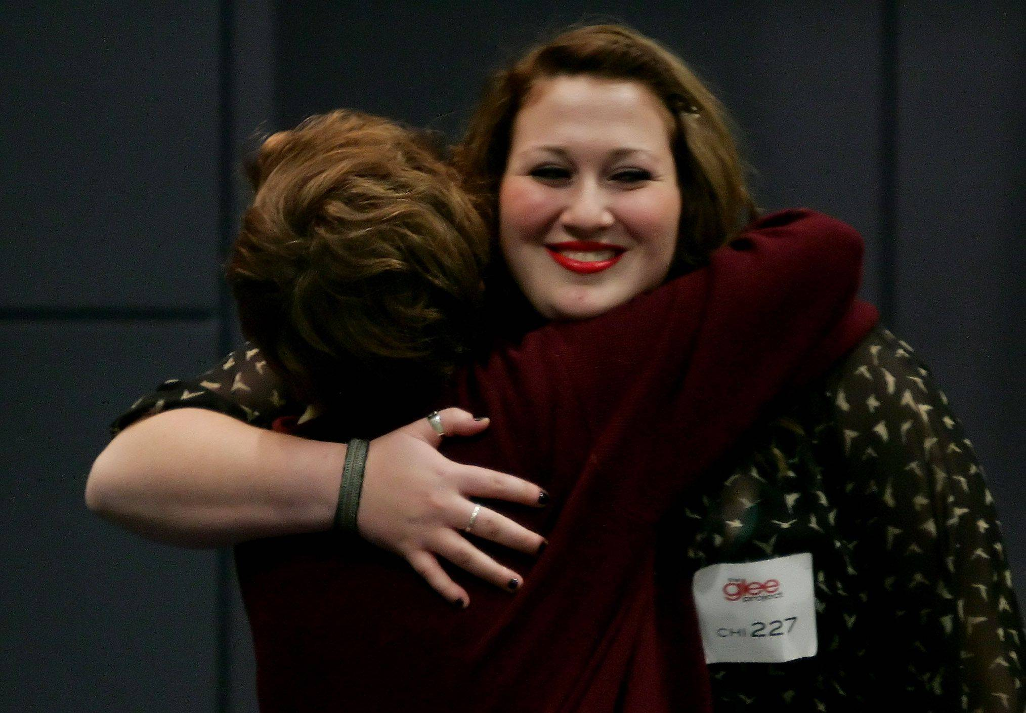 "Emily Thomas of Lake Villa is congratulated by another singer after she moves on to the next phase during tryouts for the reality series ""The Glee Project"" Sunday at McCormick Place in Chicago. The competition offers contestants a chance to win a part on the award winning FOX television show ""Glee."""