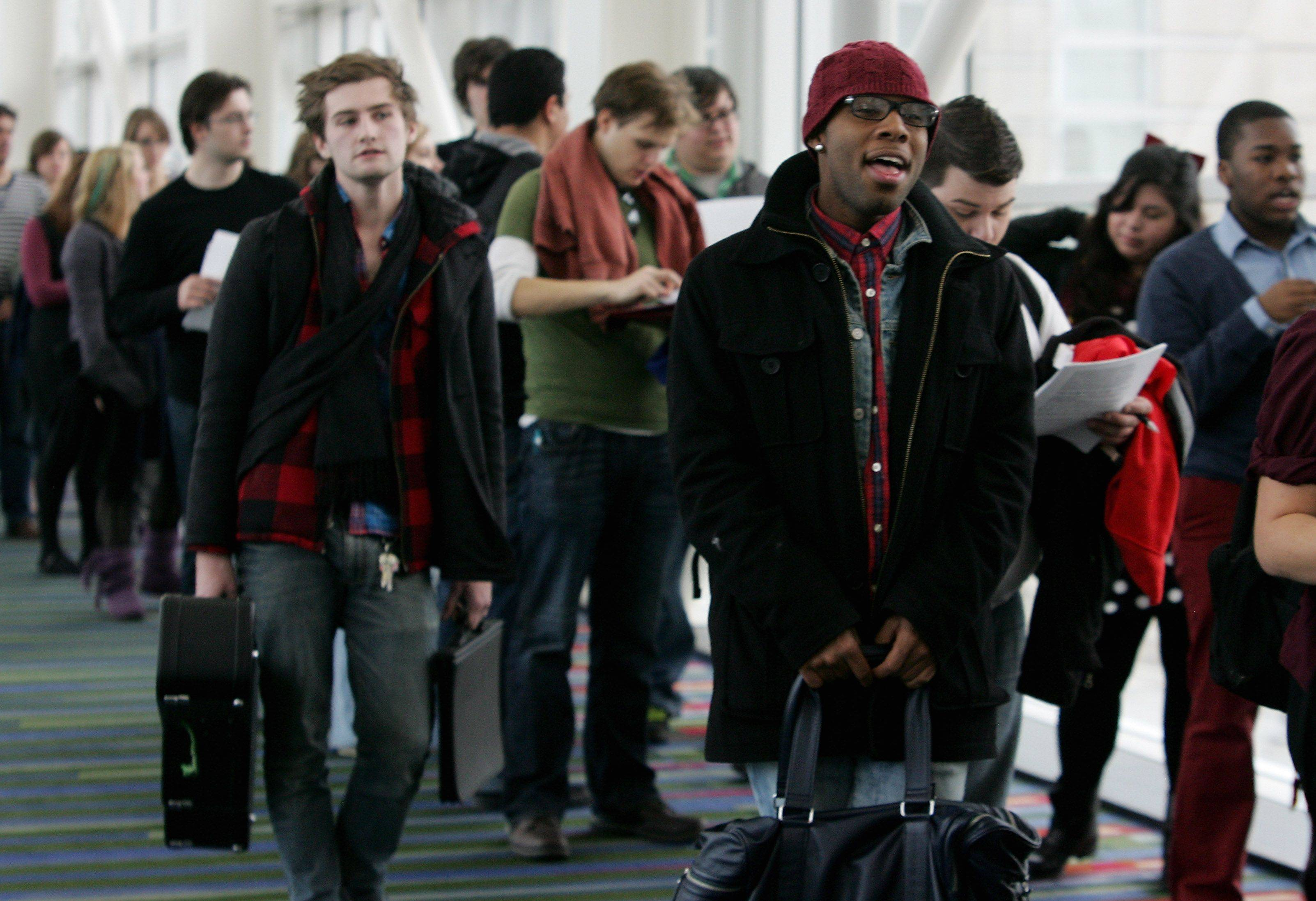 "Cody Kindle of Gurnee sings as he stands in line before tryouts for the reality series ""The Glee Project"" Sunday at McCormick Place in Chicago. The competition offers contestants a chance to win a part on the award winning FOX television show ""Glee."""