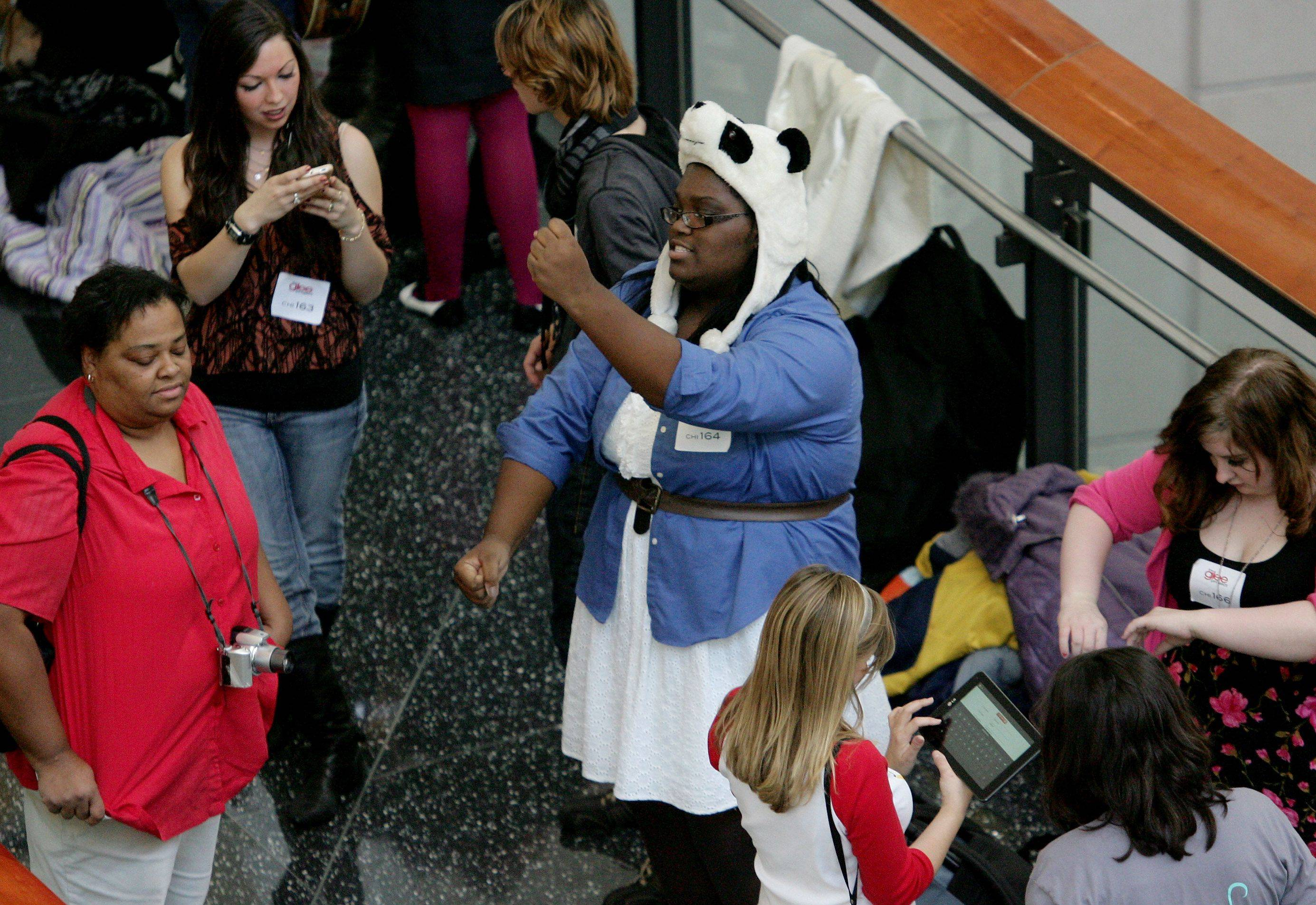 "Makesha Carter of Omaha, Nebraska wears a panda cap as she dances in the crowd during tryouts for the reality series ""The Glee Project"" Sunday at McCormick Place in Chicago. The competition offers contestants a chance to win a part on the award winning FOX television show ""Glee."""