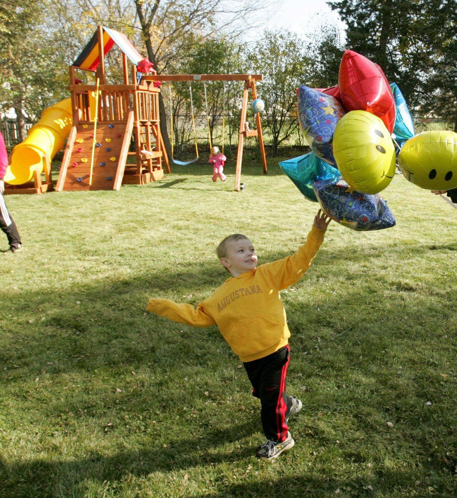 Owen Payton, who has suffered with a serious heart defect, enjoys his new backyard play set, thanks to the Make-A-Wish Foundation.