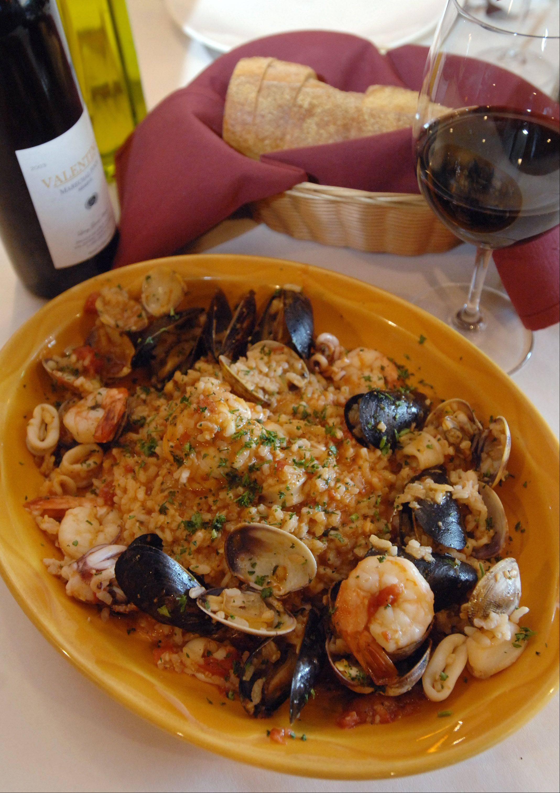 Mussels, clams, scallops, lobster, shrimp and calamari fill the seafood risotto that chef Salvatore Cardone serves at Mambo Italiano in Mundelein.