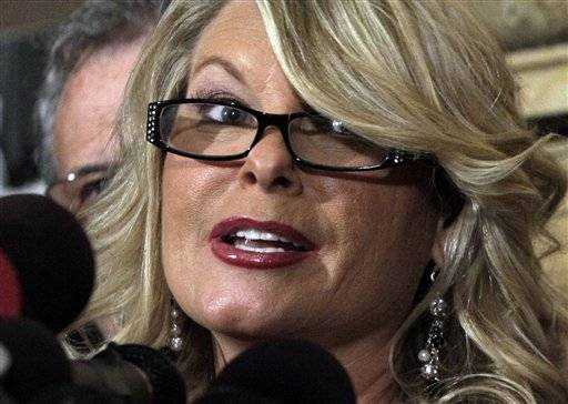 Sharon Bialek, a suburban woman, addresses a news conference at the Friars Club, Monday, Nov. 7, 2011, in New York. Bialek accused Republican presidential contender Herman Cain of making an unwanted sexual advance against her in 1997. She says she wants to provide