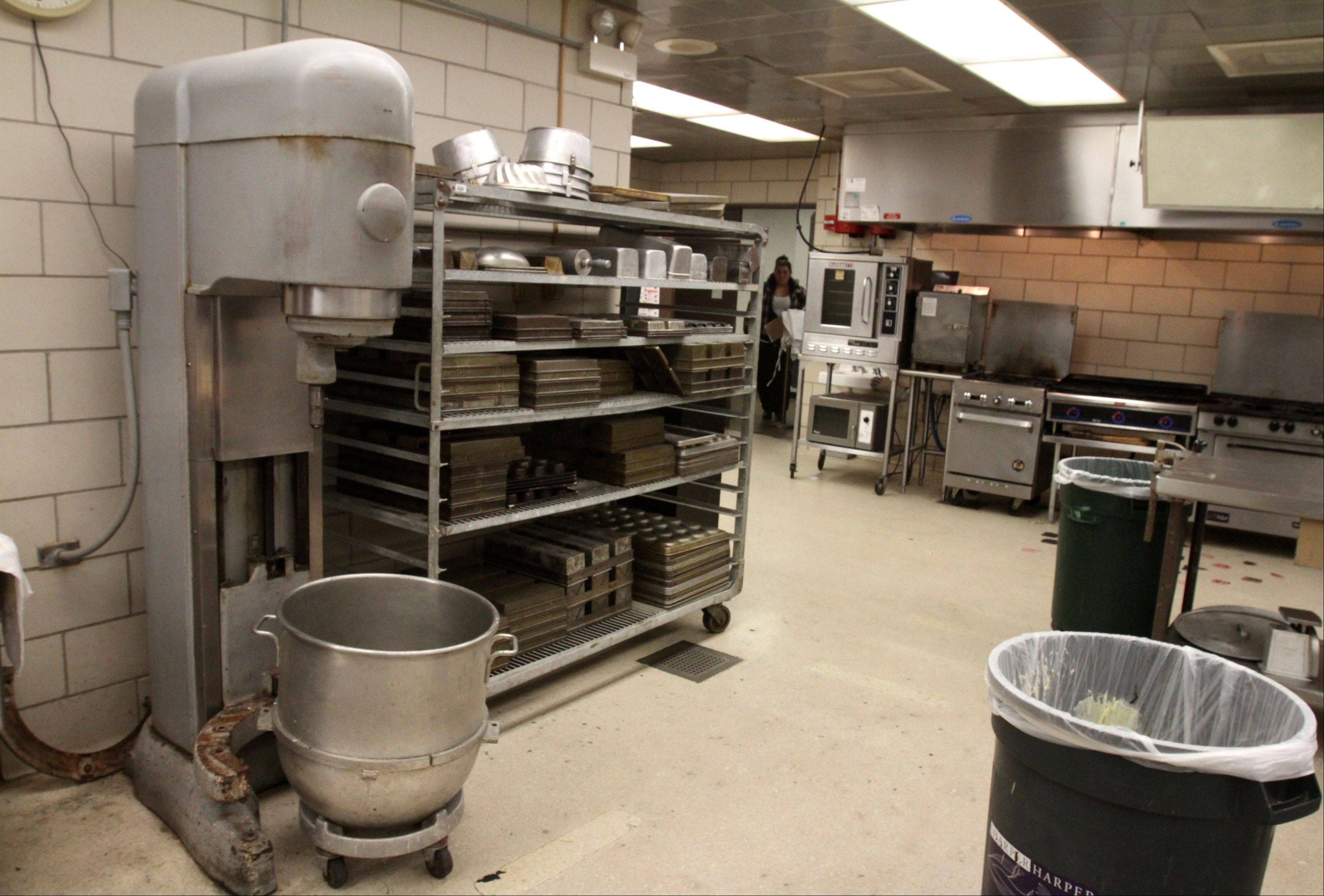 Harper College culinary and hospitality students use dated equipment in a dingy basement. More than $5 million will be spent modernizing the program under a plan being developed by the school.