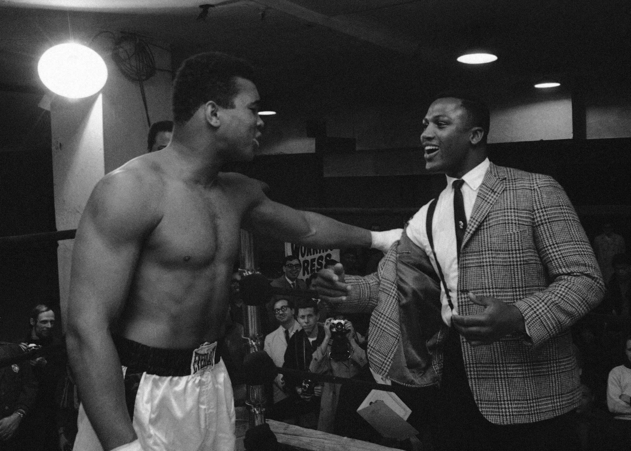 In this March 15, 1967, file photo, Joe Frazier, right, a heavyweight boxer and a contender for champion Muhammad Ali's (Cassius Clay) title, is kidded by Clay at the champion's training quarters at Madison Square Garden in New York. Frazier, the former heavyweight champion who handed Muhammad Ali his first defeat yet had to live forever in his shadow, died Monday Nov. 7, 2011, after a brief final fight with liver cancer. He was 67.