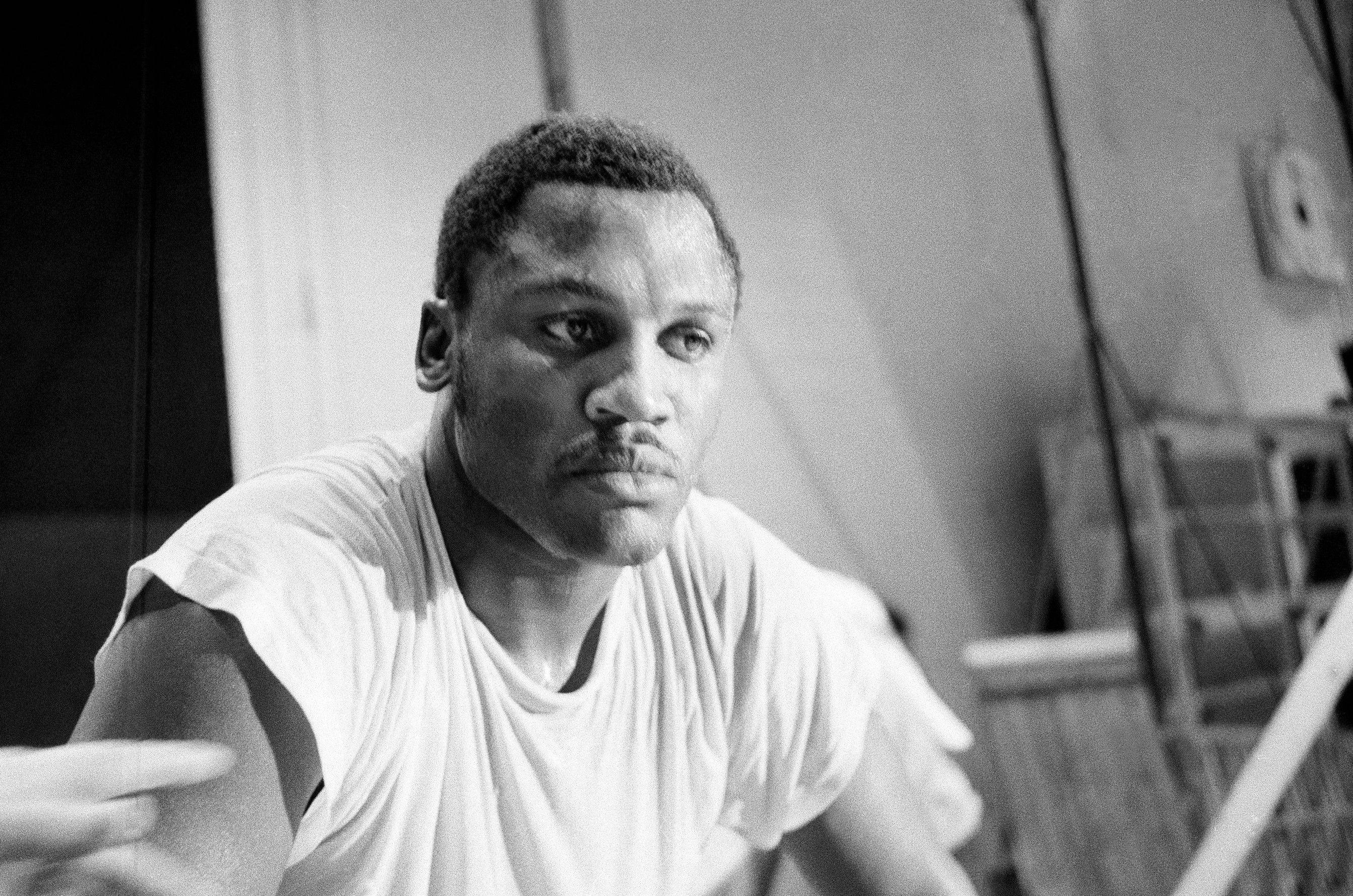 In this Feb. 3, 1970, file photo, Joe Frazier pauses after a workout at New York's Madison Square Garden. Frazier, the former heavyweight champion who handed Muhammad Ali his first defeat yet had to live forever in his shadow, has died after a brief final fight with liver cancer. He was 67. The family issued a release confirming the boxer's death on Monday night, Nov. 7, 2011.