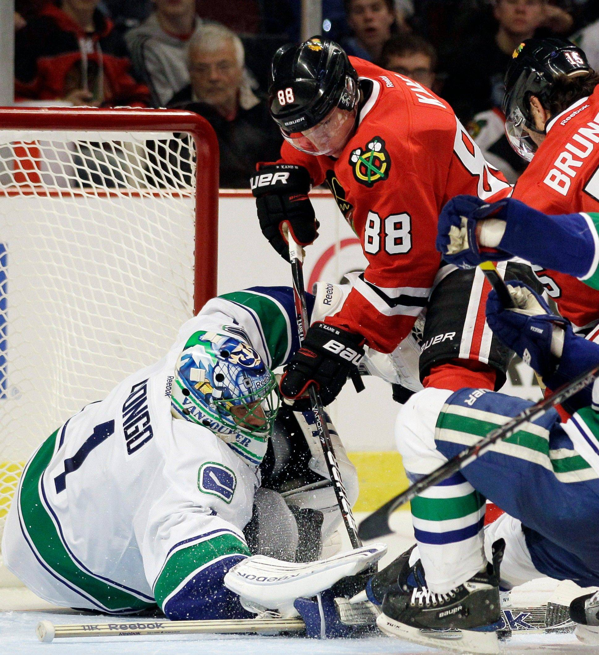 Canucks goalie Roberto Luongo saves a shot by the Blackhawks' Patrick Kane on Sunday night at the United Center.