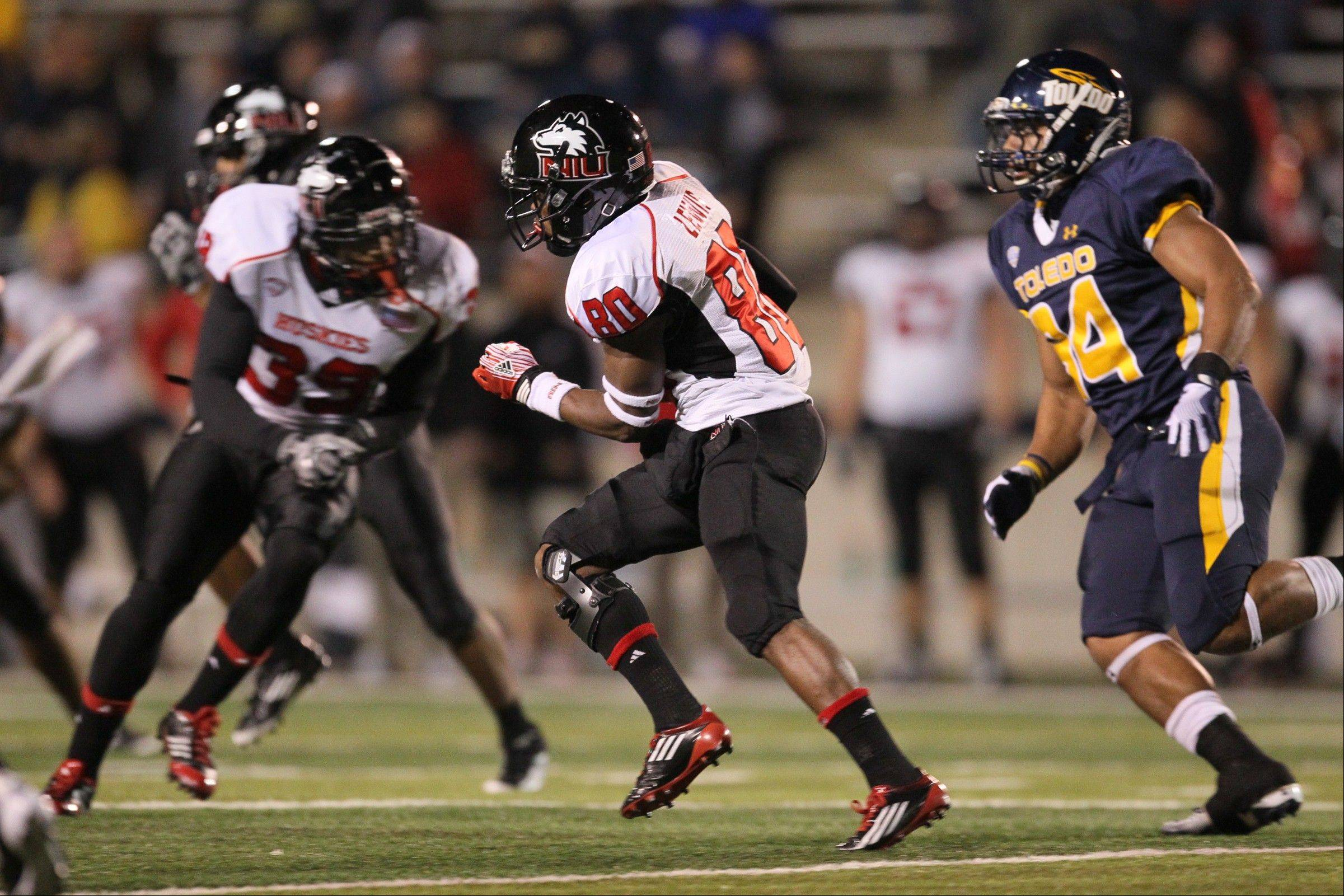 Northern Illinois' Tommylee Lewis (80) returns the opening kickoff for a 100-yard touchdown against Toledo last Tuesday. Lewis also scored on a 95-yard kick return. Next up for the Huskies, a Tuesday night game at Bowling Green.
