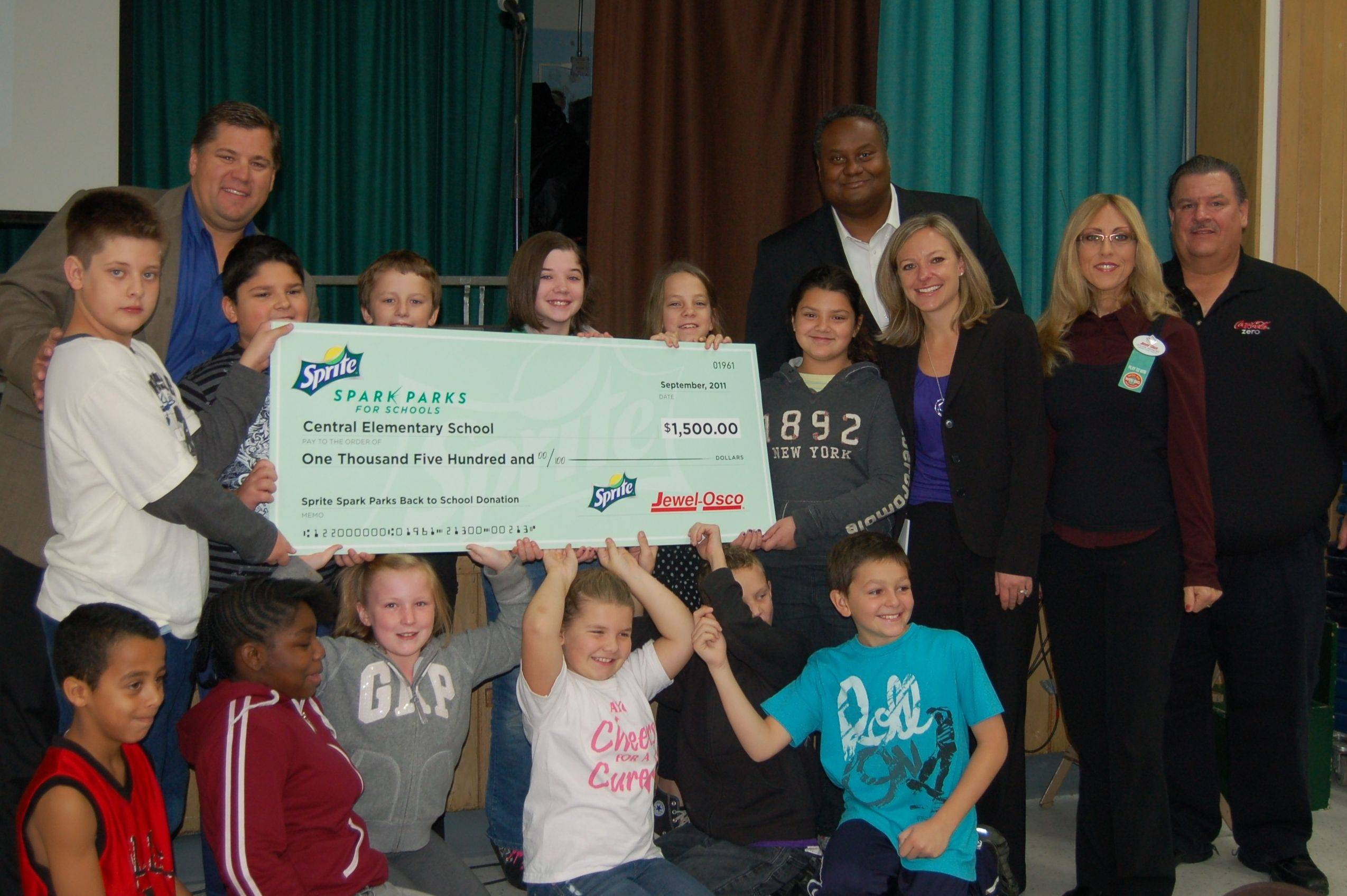 Jewel-Osco representatives Phil Alcot and Sylvia Reinoce joined Coke representatives Jason Cunningham and Dave Lesiak to present Central Principal Kelly Krueger and fourth- and fifth-grade student council members a $1,500 check as part of the Sprite Spark Parks Project for Schools program.
