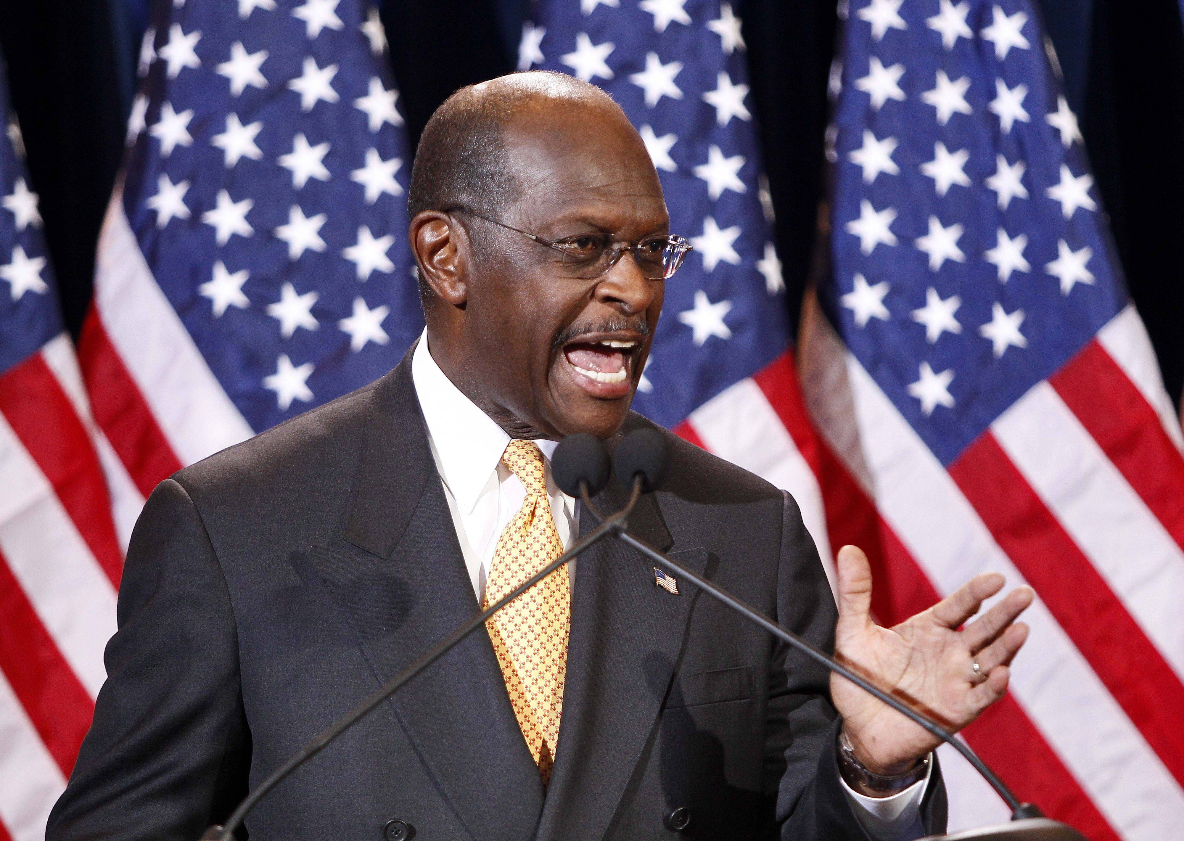 Republican presidential candidate Herman Cain addresses the media Tuesday in Scottsdale, Ariz. Cain was responding to Sharon Bialek, a Glenview woman who accused Cain of making an unwanted sexual advance against her in 1997.