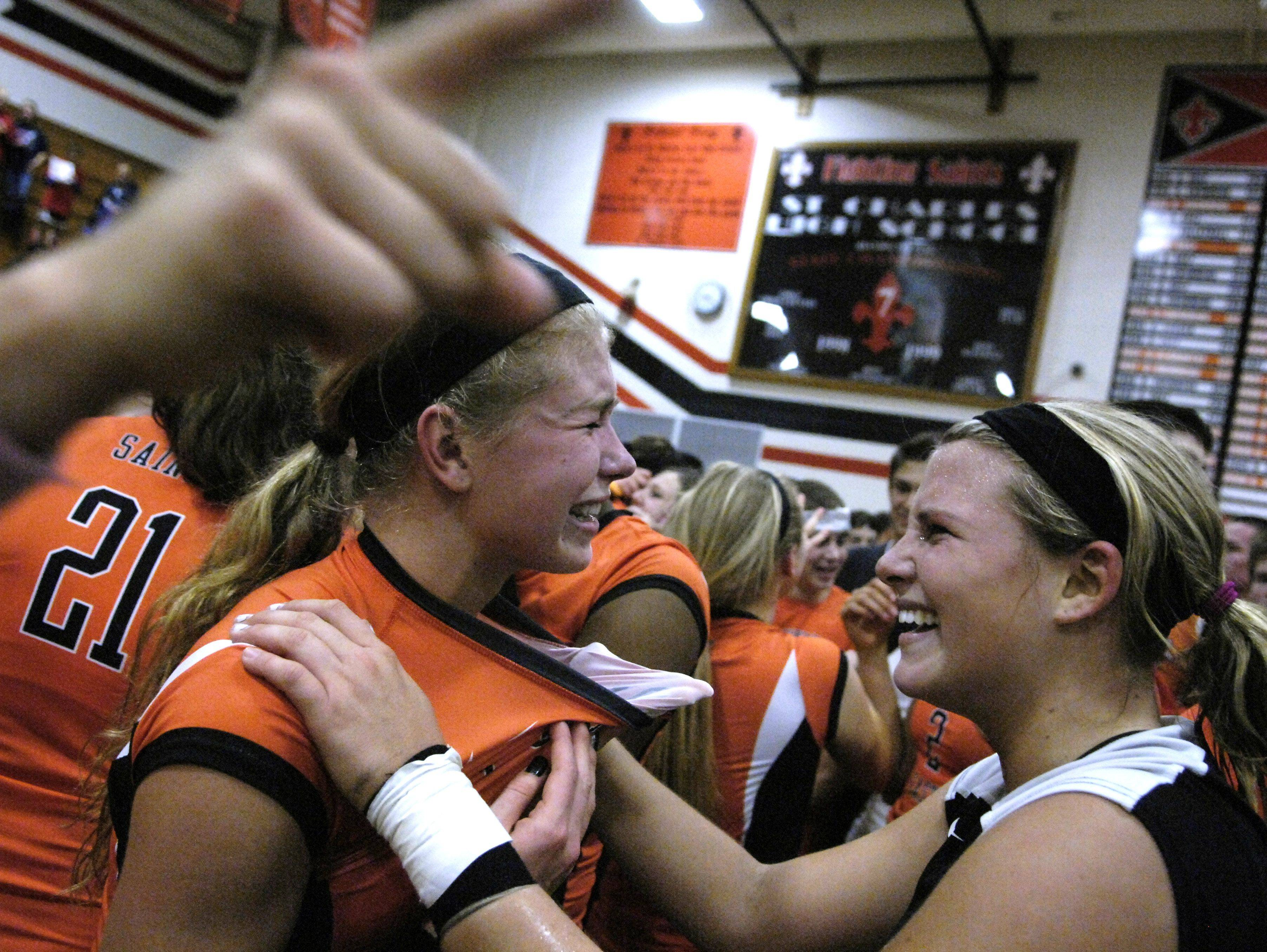 St. Charles East's Maisey Mulvey, right, and Meghan Niski celebrate after winning Thursday's sectional final in St. Charles.