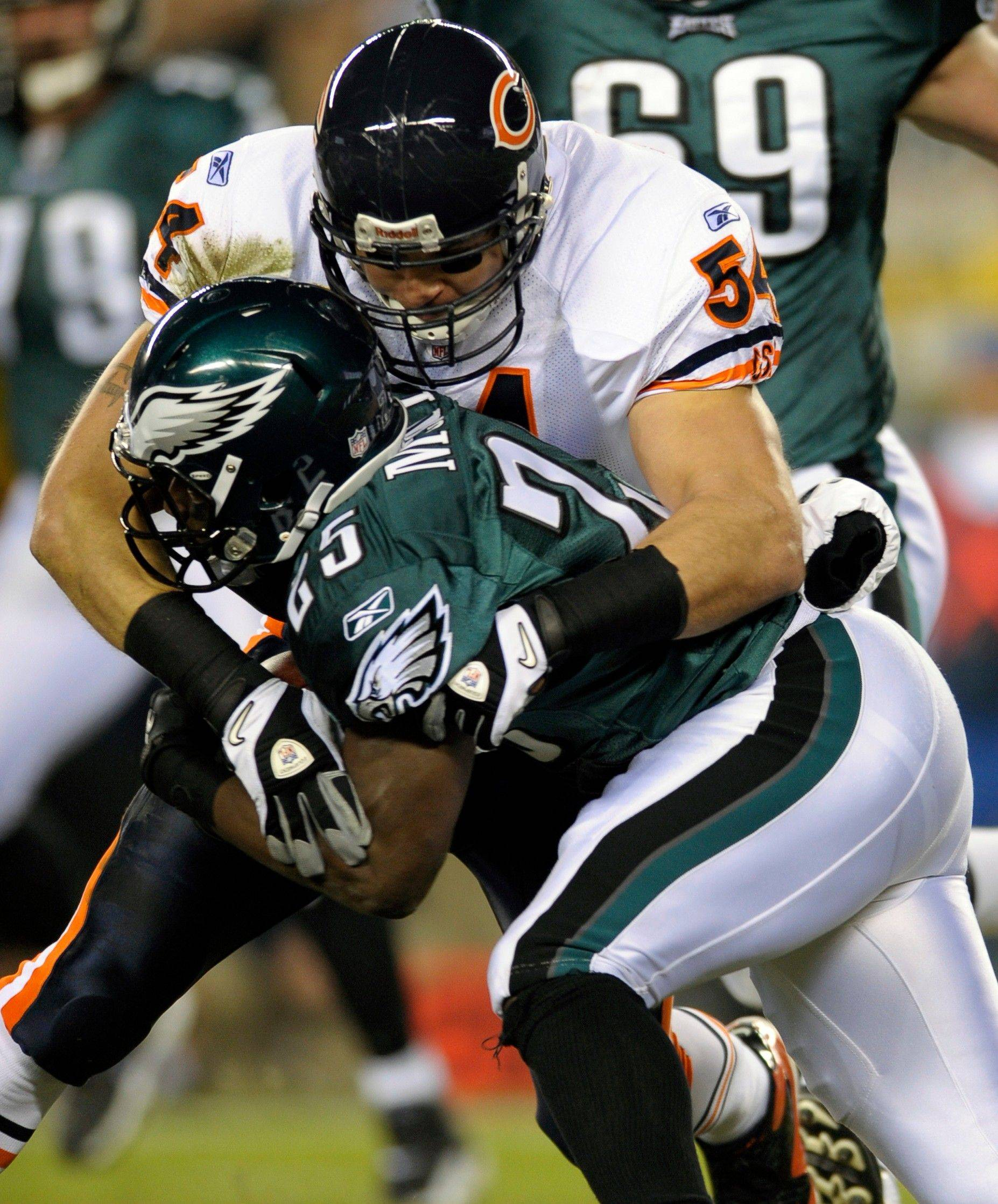 Bears linebacker Brian Urlacher makes things tough for Eagles running back LeSean McCoy during Monday's victory.