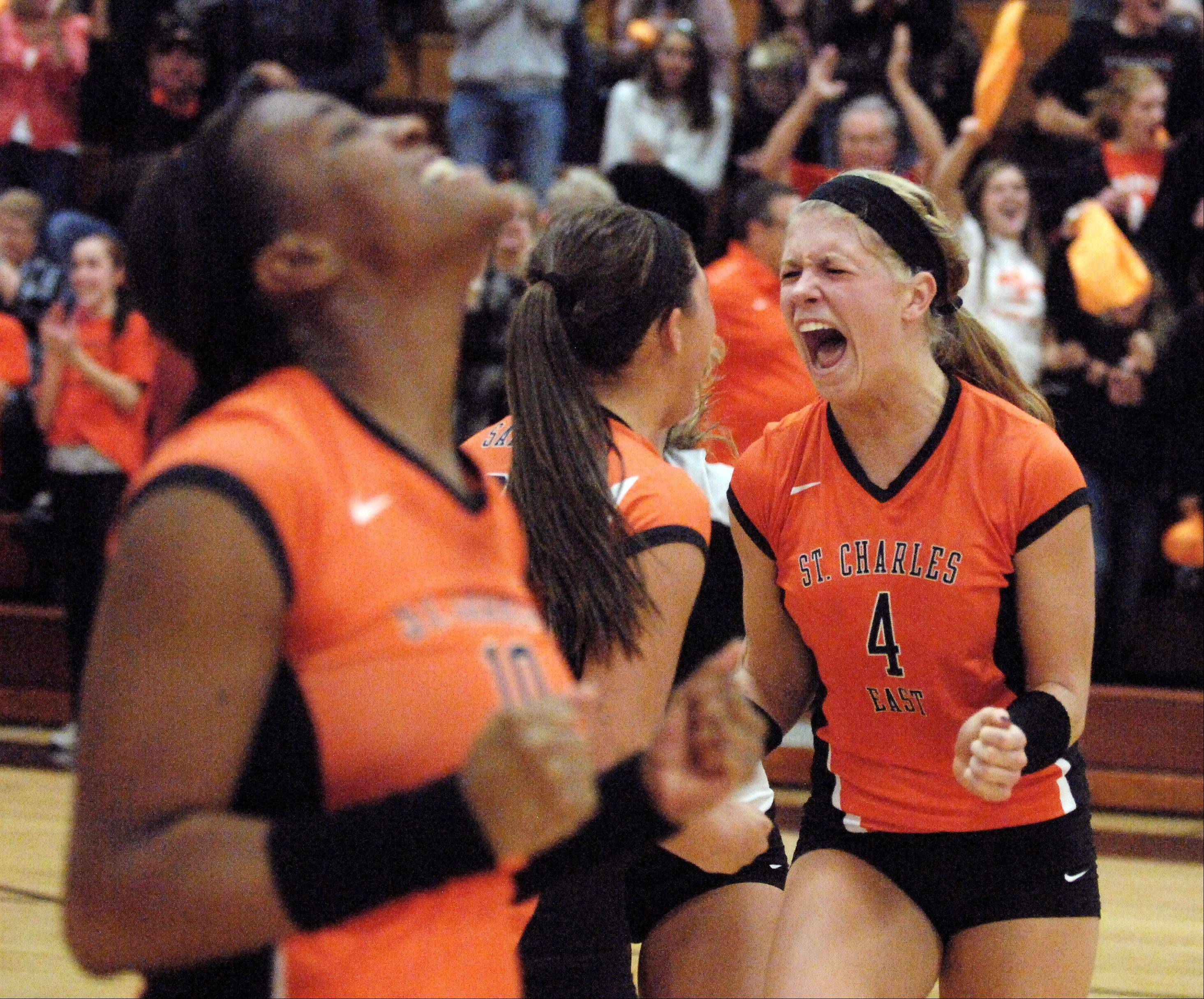 St. Charles East's Meghan Niski, 4, and her teammates erupt as they they score the clinching point and win Thursday's sectional final against York in St. Charles.