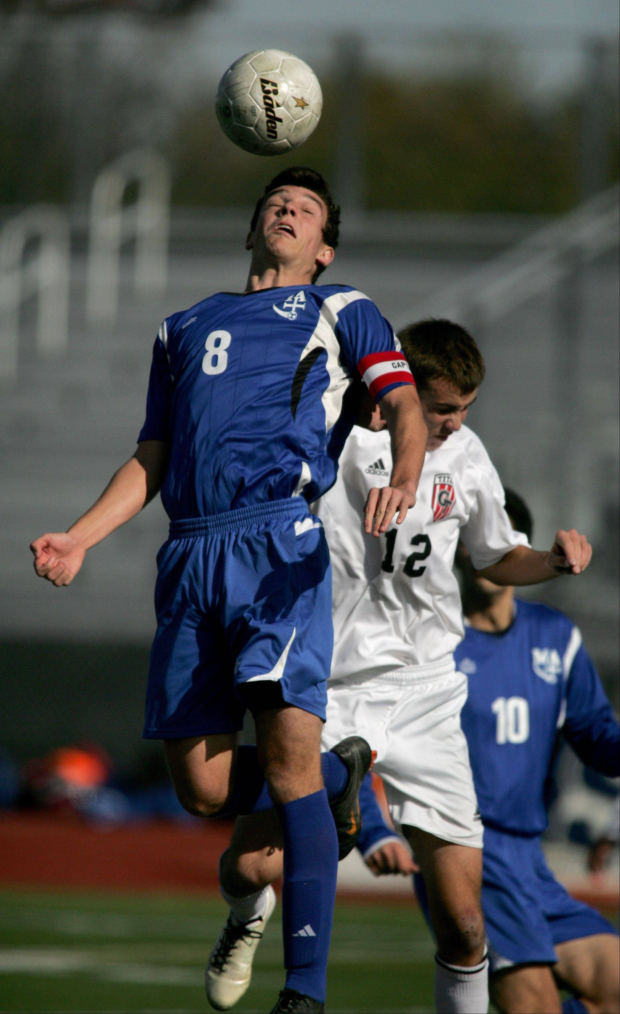 Marmion's Mike Frasca goes up for the header against Chatham Glenwood in Class 2A state soccer semifinals Friday at Lincoln-Way North High School in Frankfort.