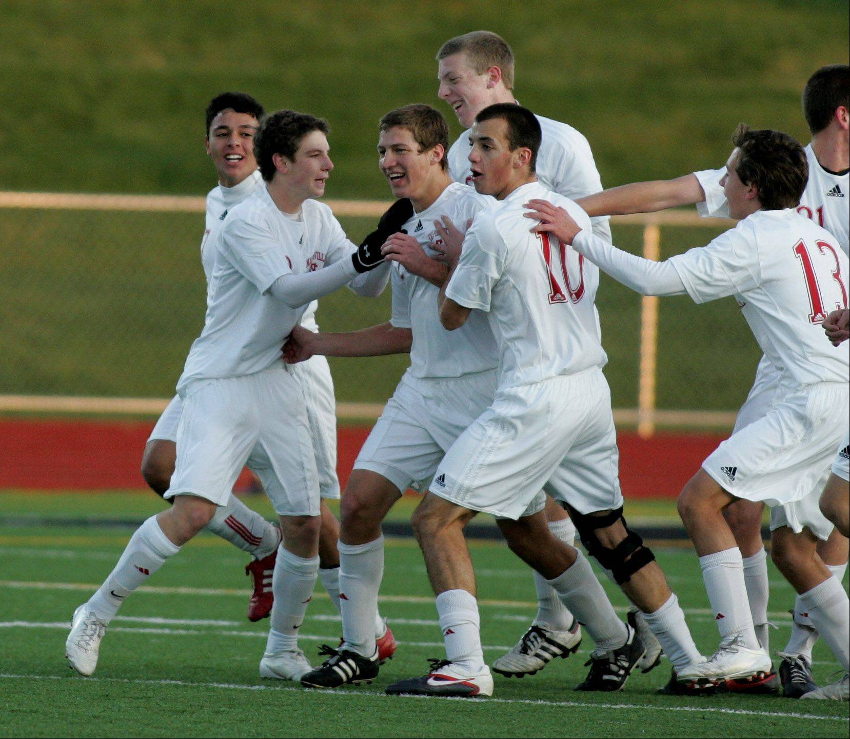 Naperville Central celebrates a goal by Adam Hamlielec, third from left, in action against Fremd in Class 3A state soccer semifinals Friday at Lincoln-Way North High School in Frankfort.