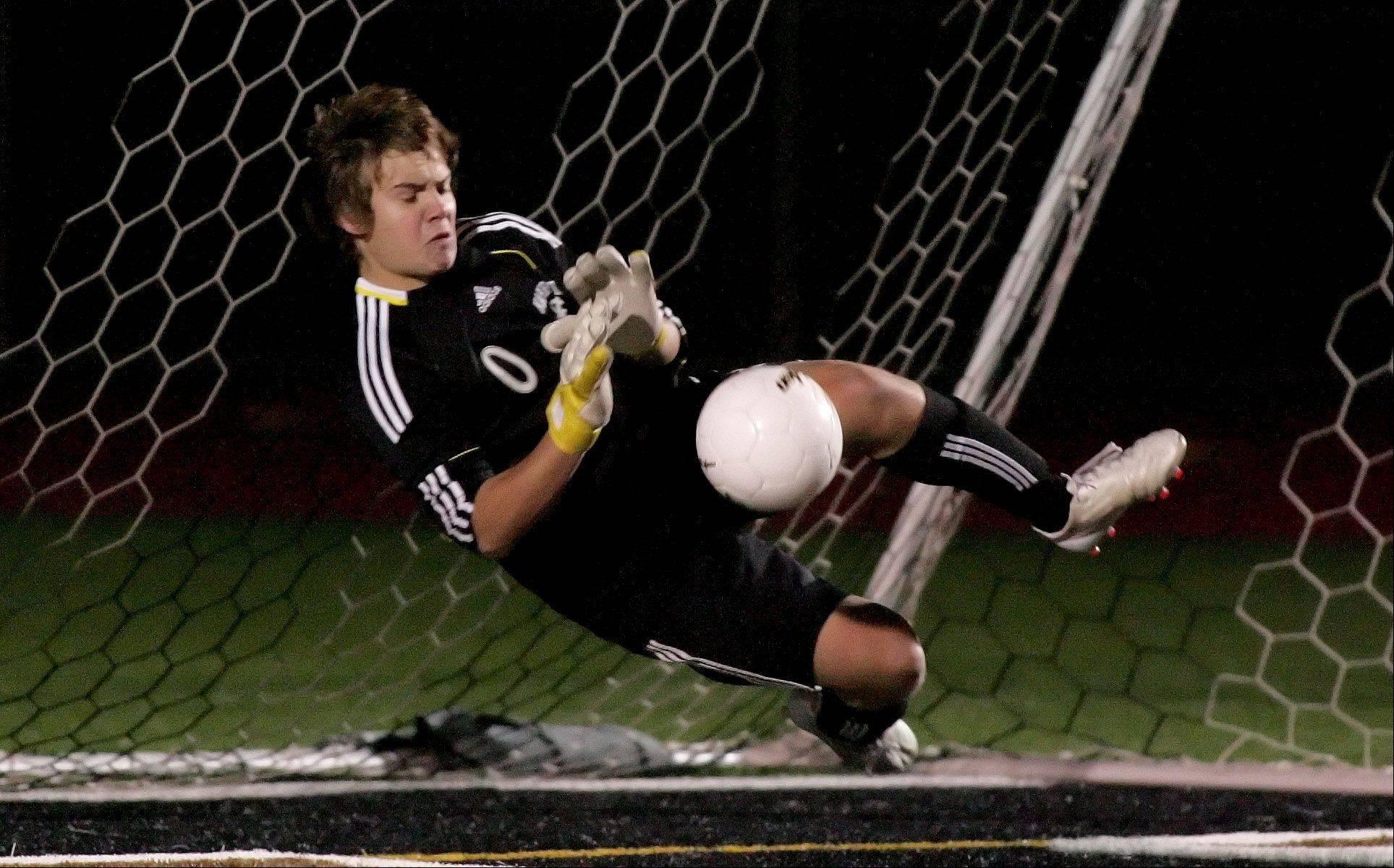 Mike Pavliga, goalkeeper for Naperville Central blocks a shot by Fremd during the shootout in Class 3A state soccer semifinals Friday at Lincoln-Way North High School in Frankfort. Naperville won 4-3
