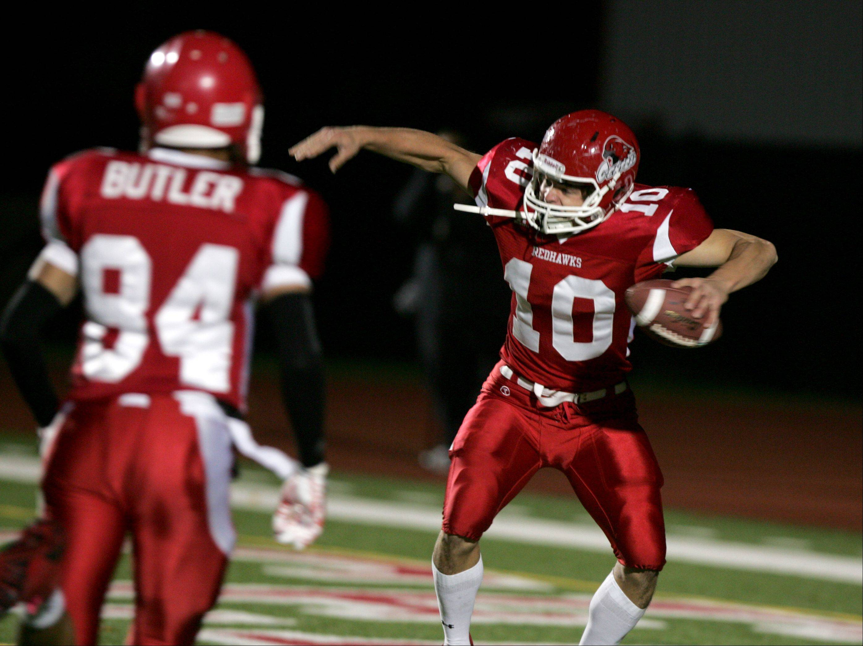Naperville Central's John Dicianni, 10, celebrates his first-half touchdown against Belleville East during the second round of IHSA football playoffs in Naperville.