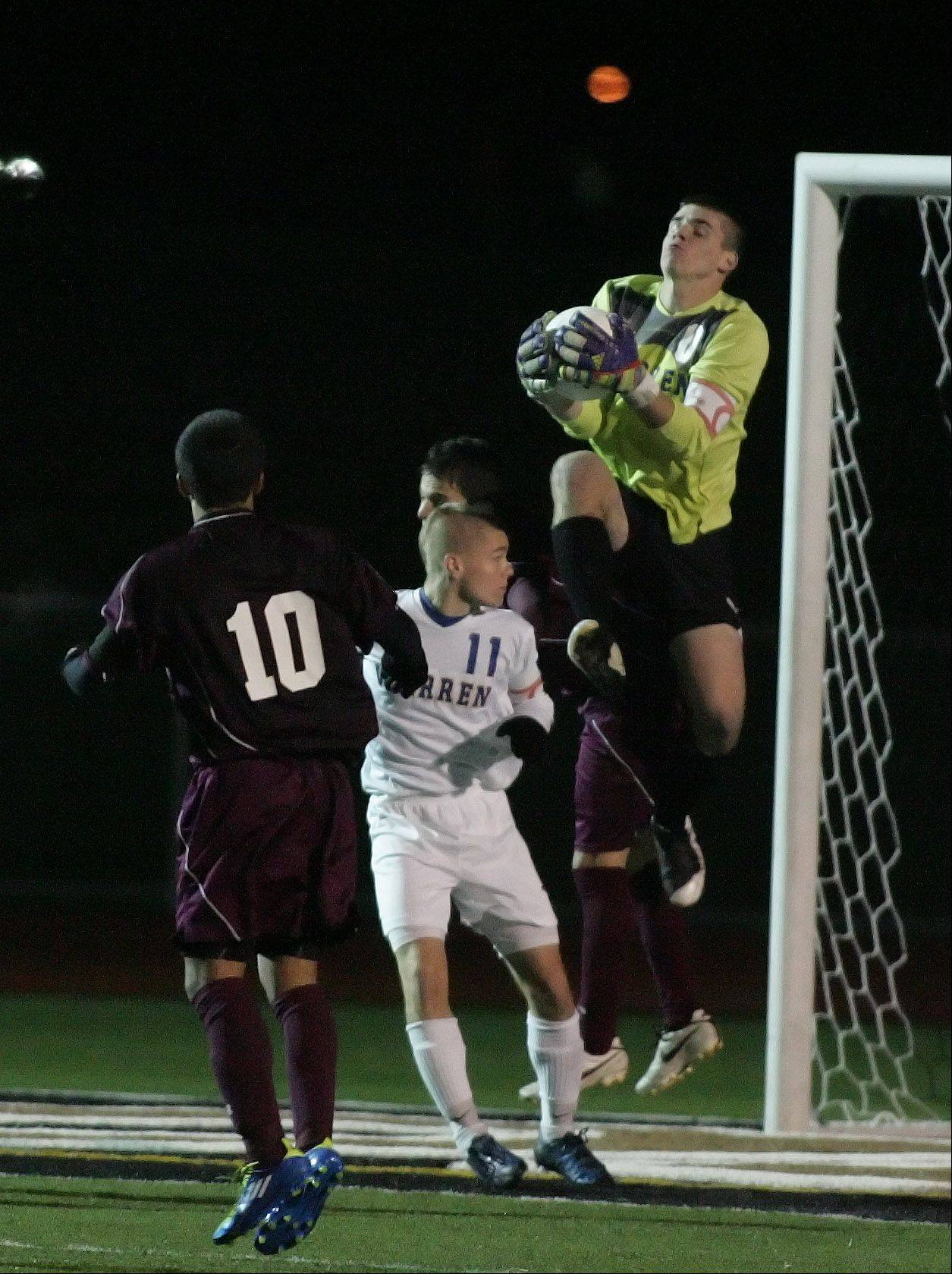 Warren Goalkeeper Brady Walsh makes a save in action against Morton in Class 3A state soccer semifinals Friday at Lincoln-Way North High School in Frankfort.