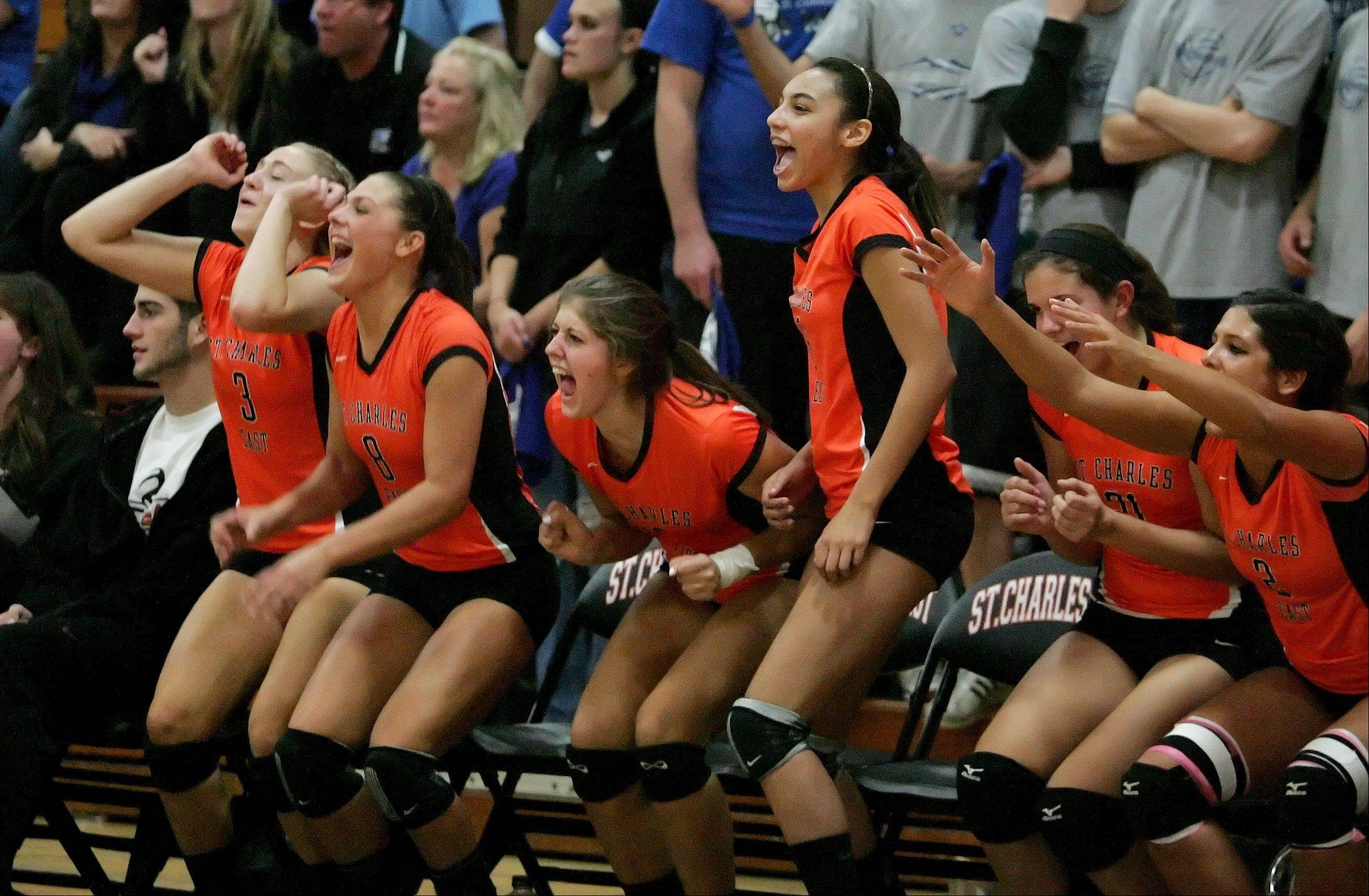 The St. Charles East bench reacts during their 2-1 win over St. Charles North in Class 4A sectional volleyball semifinals Tuesday.