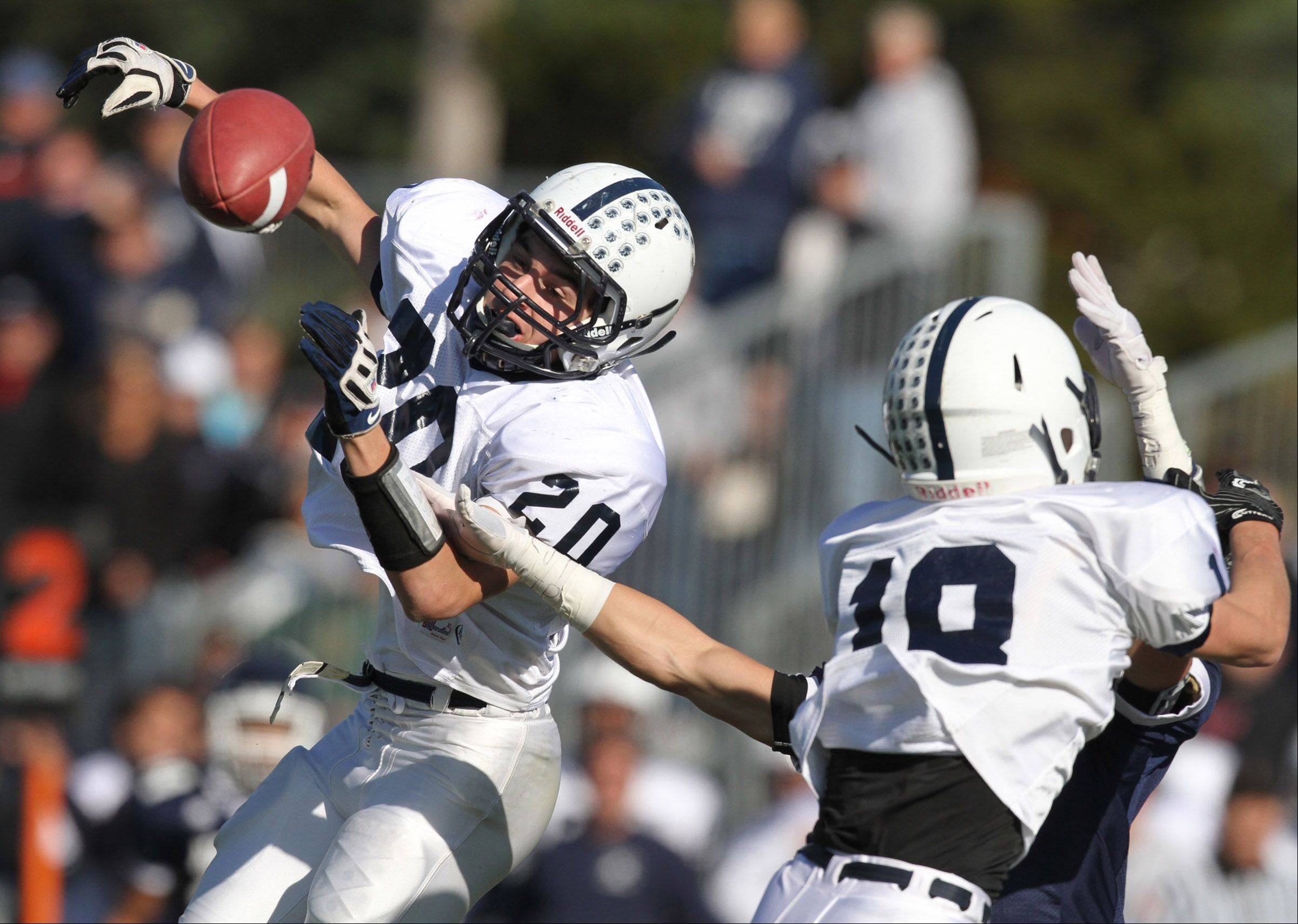 Cary-Grove defensive-back Sean Keadyjust missed intercepting this pass by Nazareth Academy quarterback on Saturday.