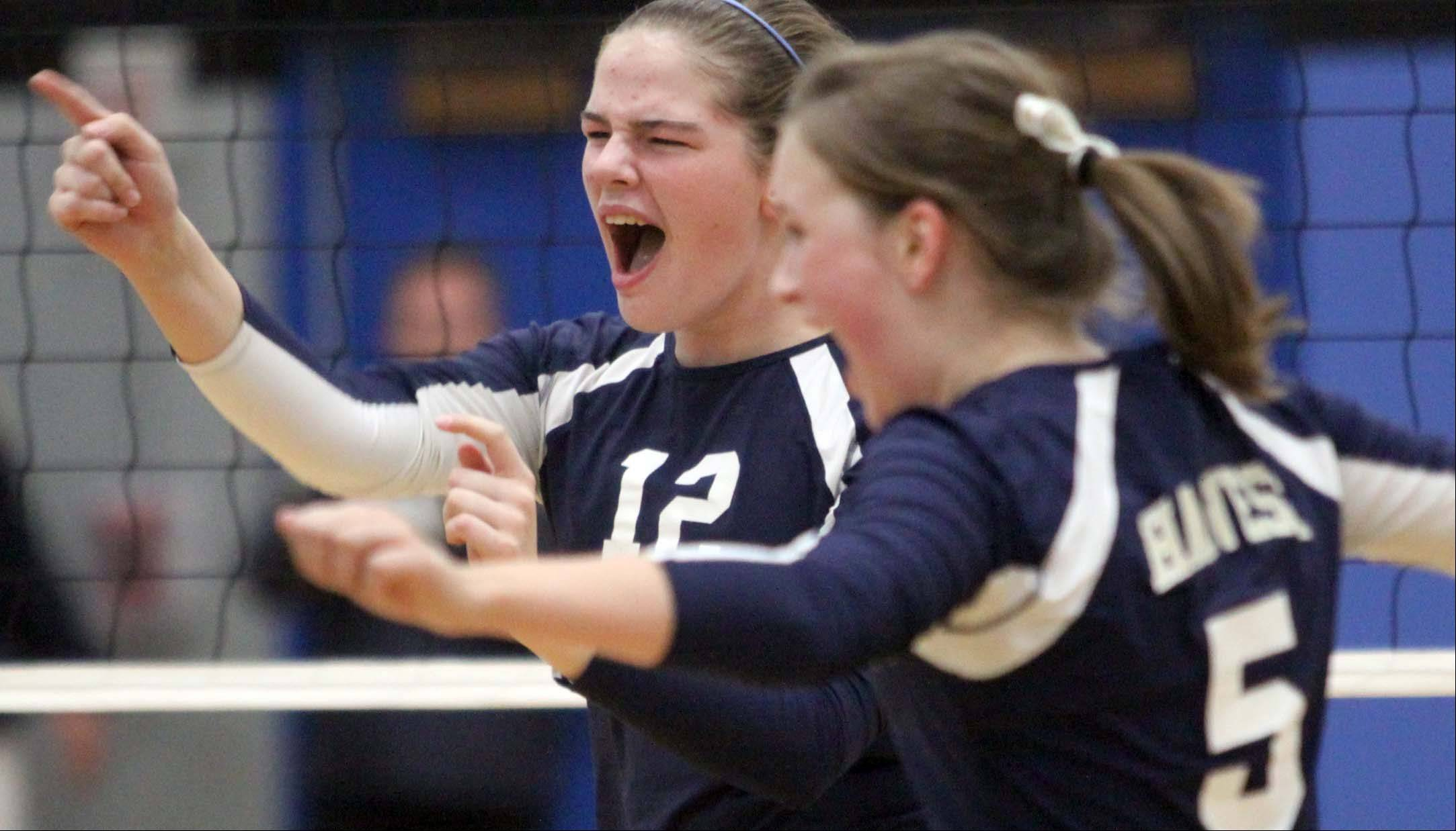 Harvest Christian Academy's Sarah Kott, left, and Katelyn Floyd celebrate a victory over Morgan Park Academy in sectional semifinal volleyball action at Westminster Christian School in Elgin on Tuesday night.