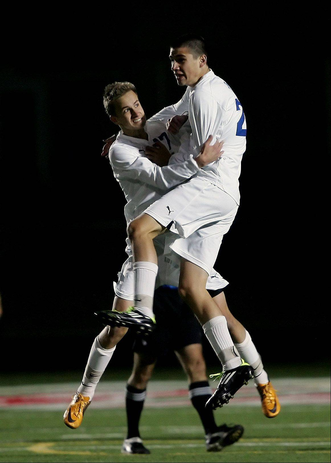 Warren's Nick Wegrzynowicz, left, celebrates with Ryan Friend after a goal during the Class 3A Barrington boys soccer supersectional Tuesday against Schaumburg.