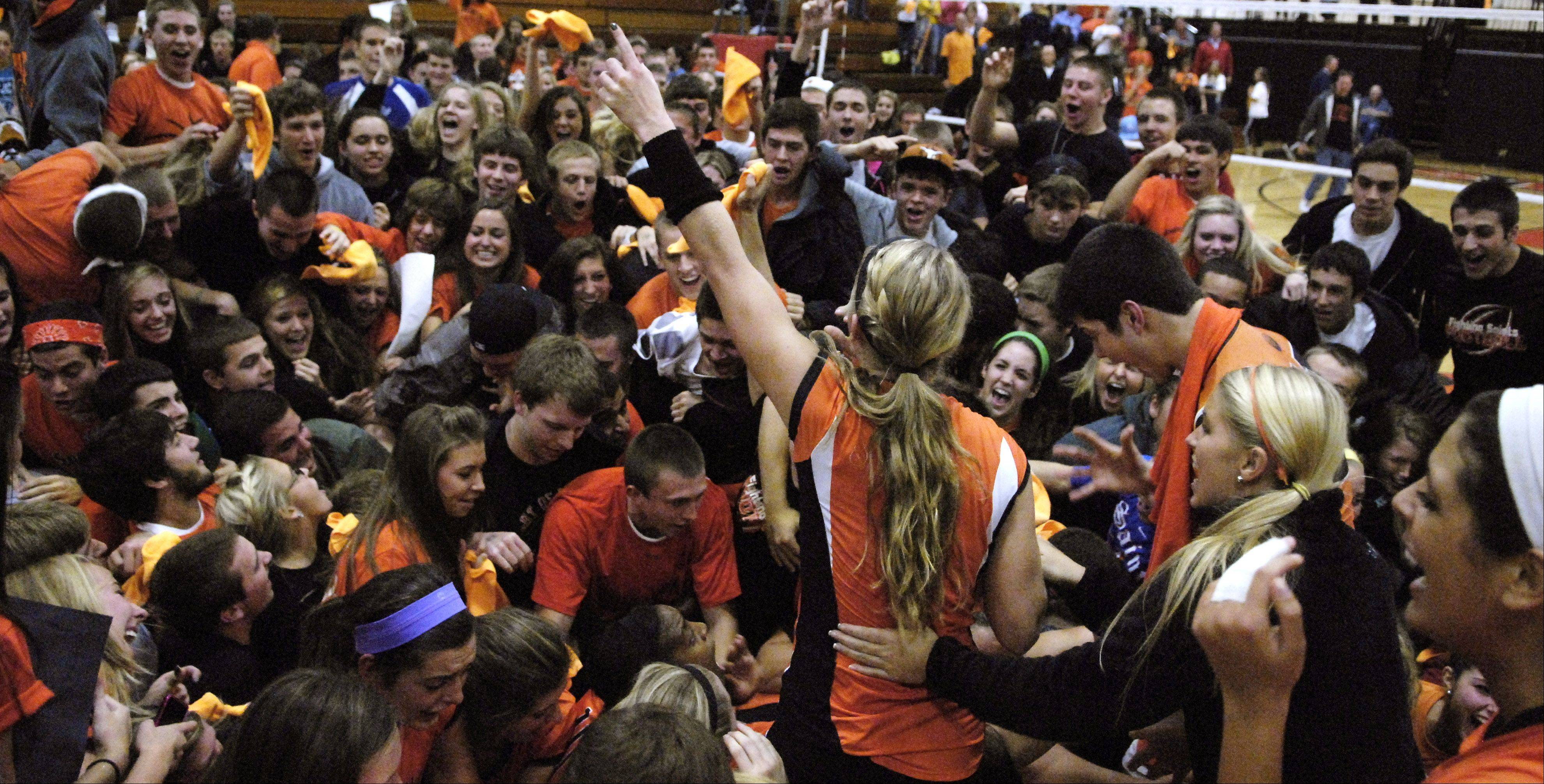 St. Charles East students flood the court after the Saints won Thursday's sectional final against York in St. Charles.