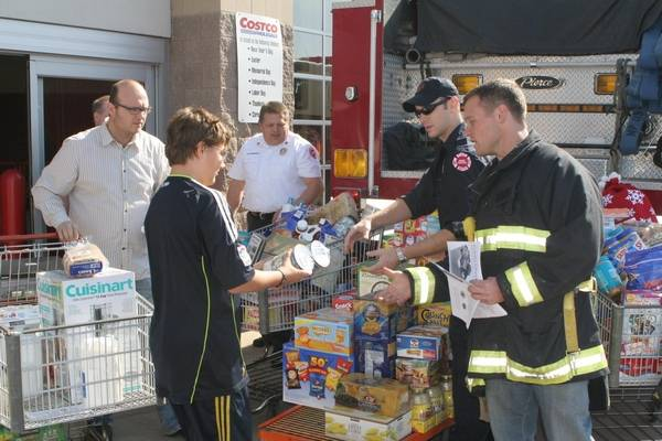 mount prospect firefighters collect donated food items from costco customers