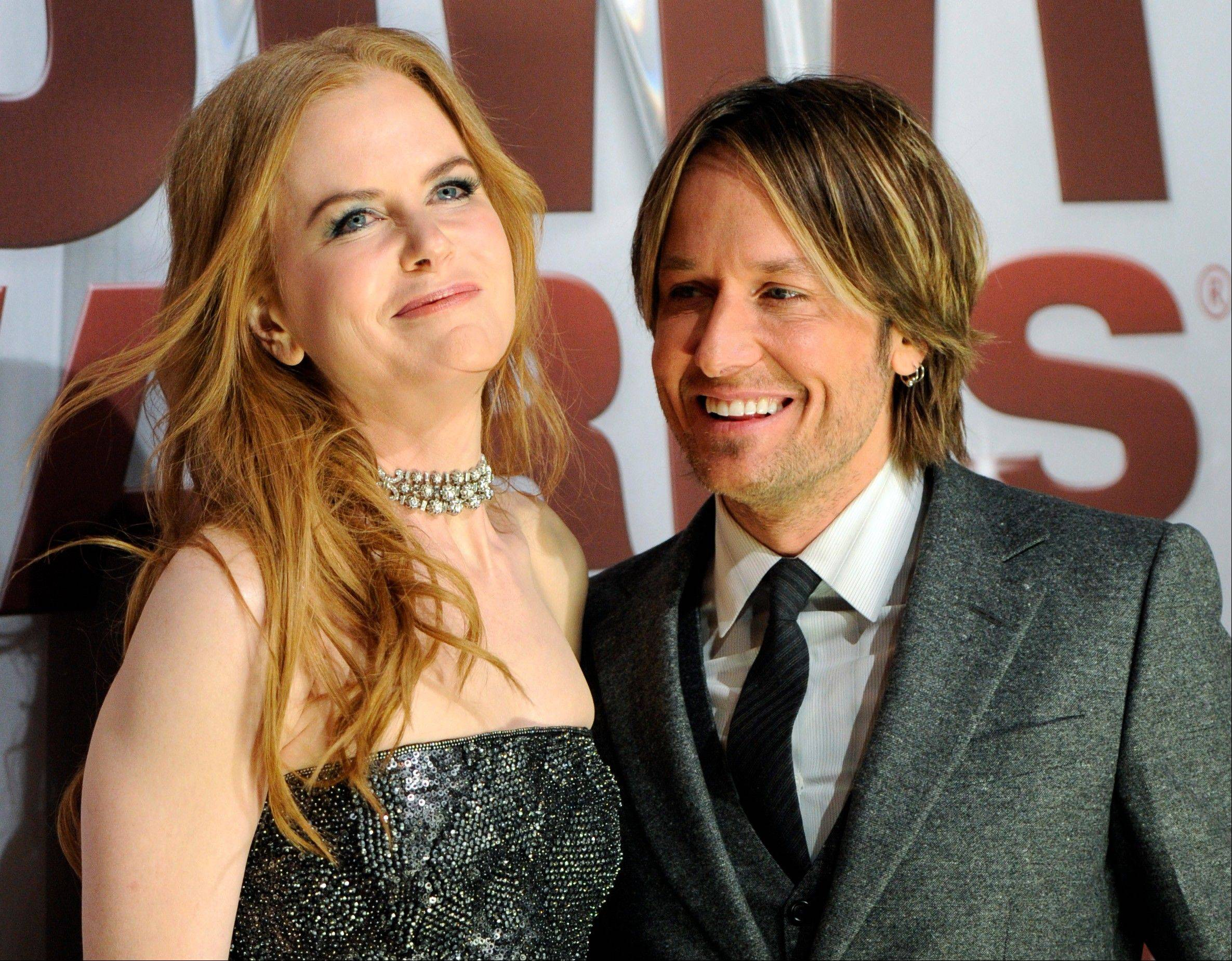 Nicole Kidman and Keith Urban arrive at the 45th Annual CMA Awards in Nashville. (AP Photo/Evan Agostini)
