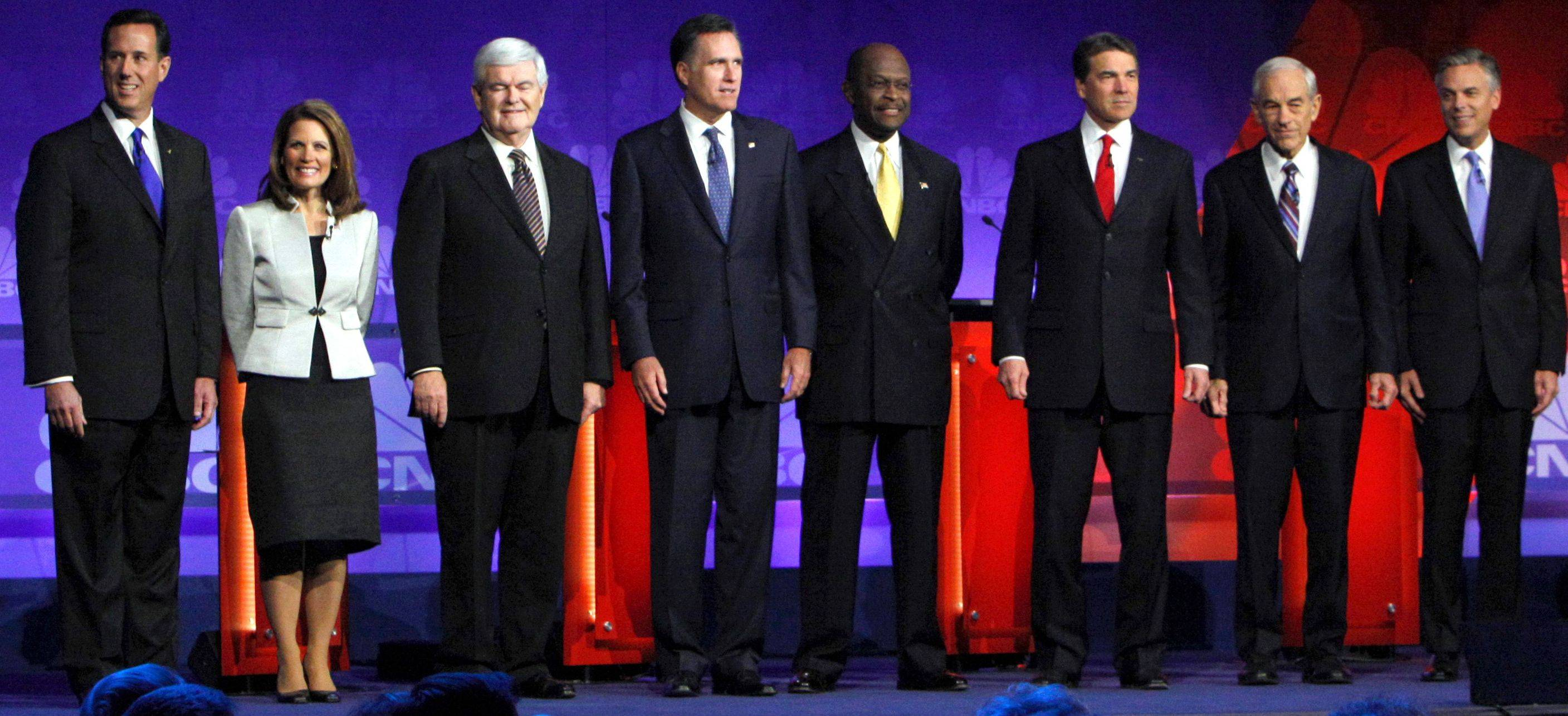 Candidates former Pennsylvania Sen. Rick Santorum, left, Rep. Michele Bachmann of Minnesota, former House Speaker Newt Gingrich, former Massachusetts Gov. Mitt Romney, businessman Herman Cain, Texas Gov. Rick Perry, Rep. Ron Paul of Texas and former Utah Gov. Jon Huntsman pose before a Republican presidential debate in Auburn Hills, Mich., Wednesday.