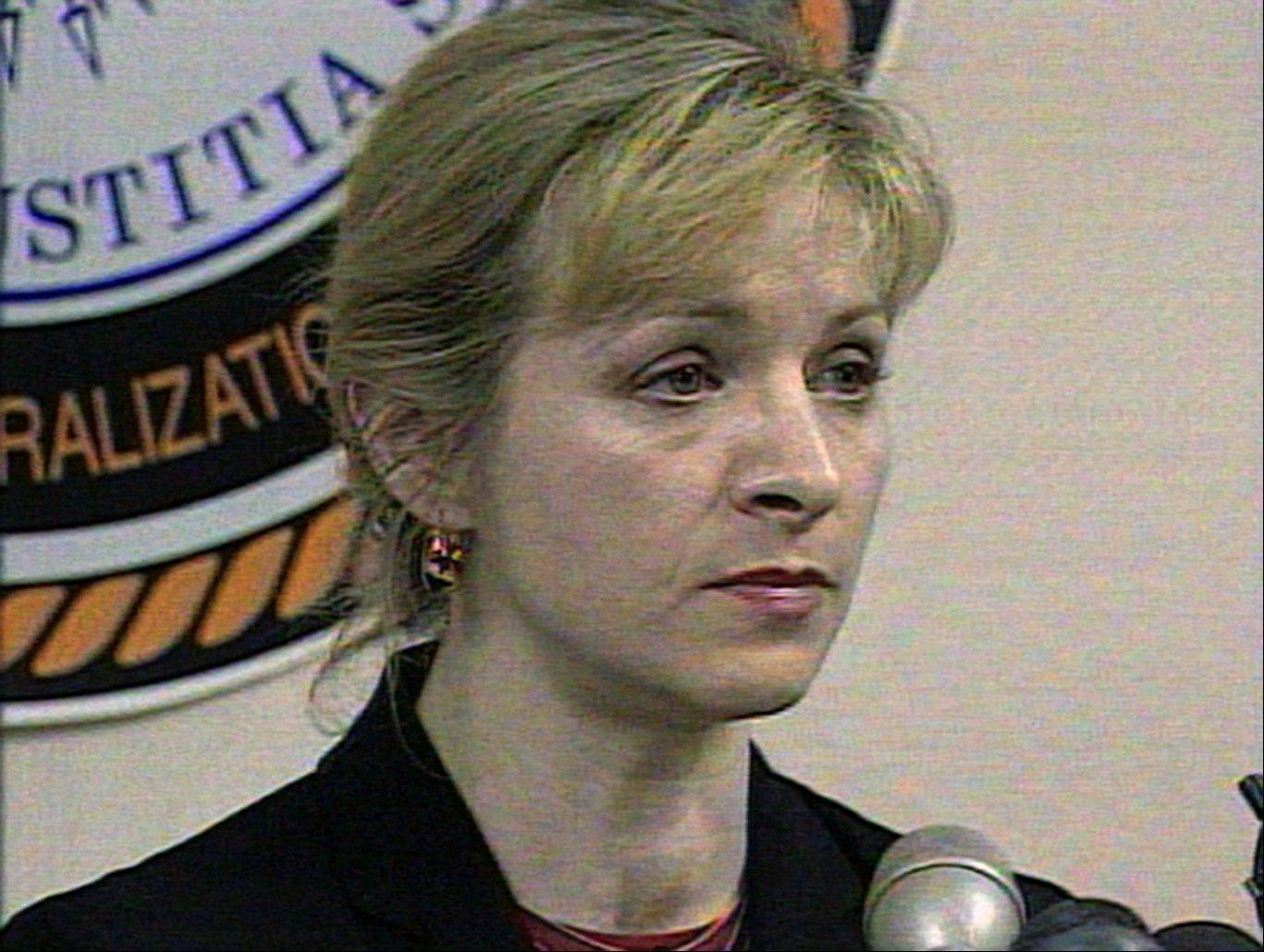 This December 1999 image from video shows then-Immigration and Naturalization Service spokesperson Karen Kraushaar. She is one of two women who have come forward publicly to allege they were sexually harassed by Republican presidential candidate Herman Cain.